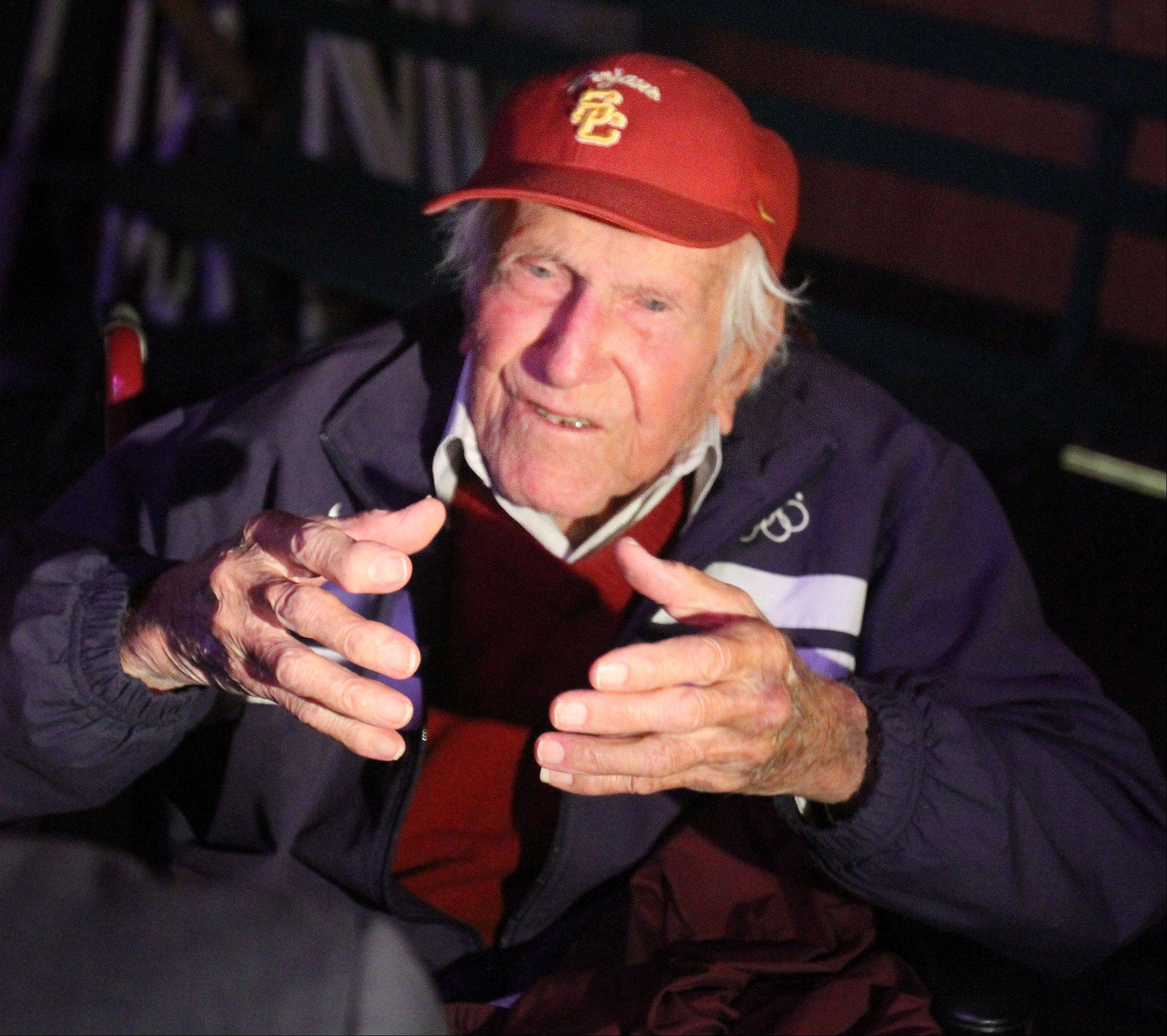 "Lou Zamperini, 94, whose World War II heroics are the subject of a best-selling book ""Unbroken"" spoke to students and fellow military veterans at Barrington High School on Tuesday, April 3rd."
