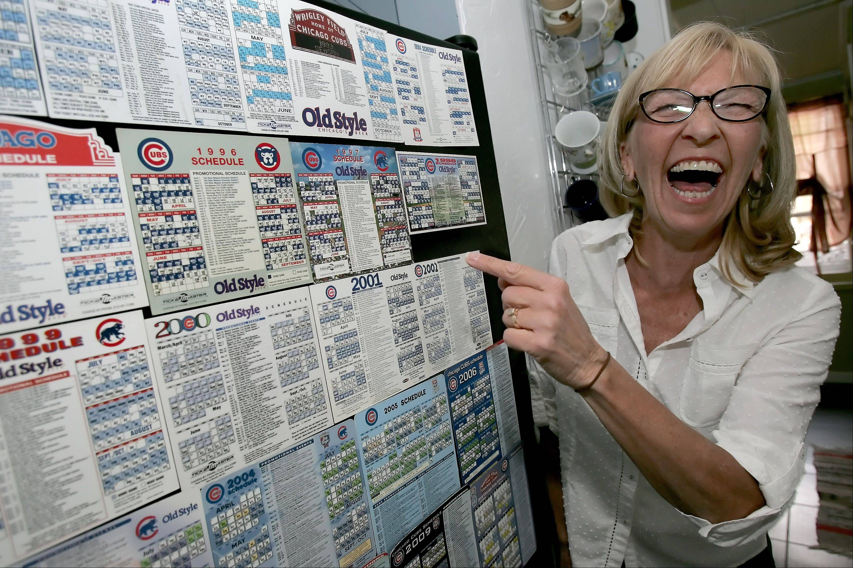 Debra Hruby of Wheaton shows off her collection of magnets received at Chicago Cubs home openers since 1990. For the past 28 years the Hruby family has been going to the Cubs home opener and sitting in the bleachers.