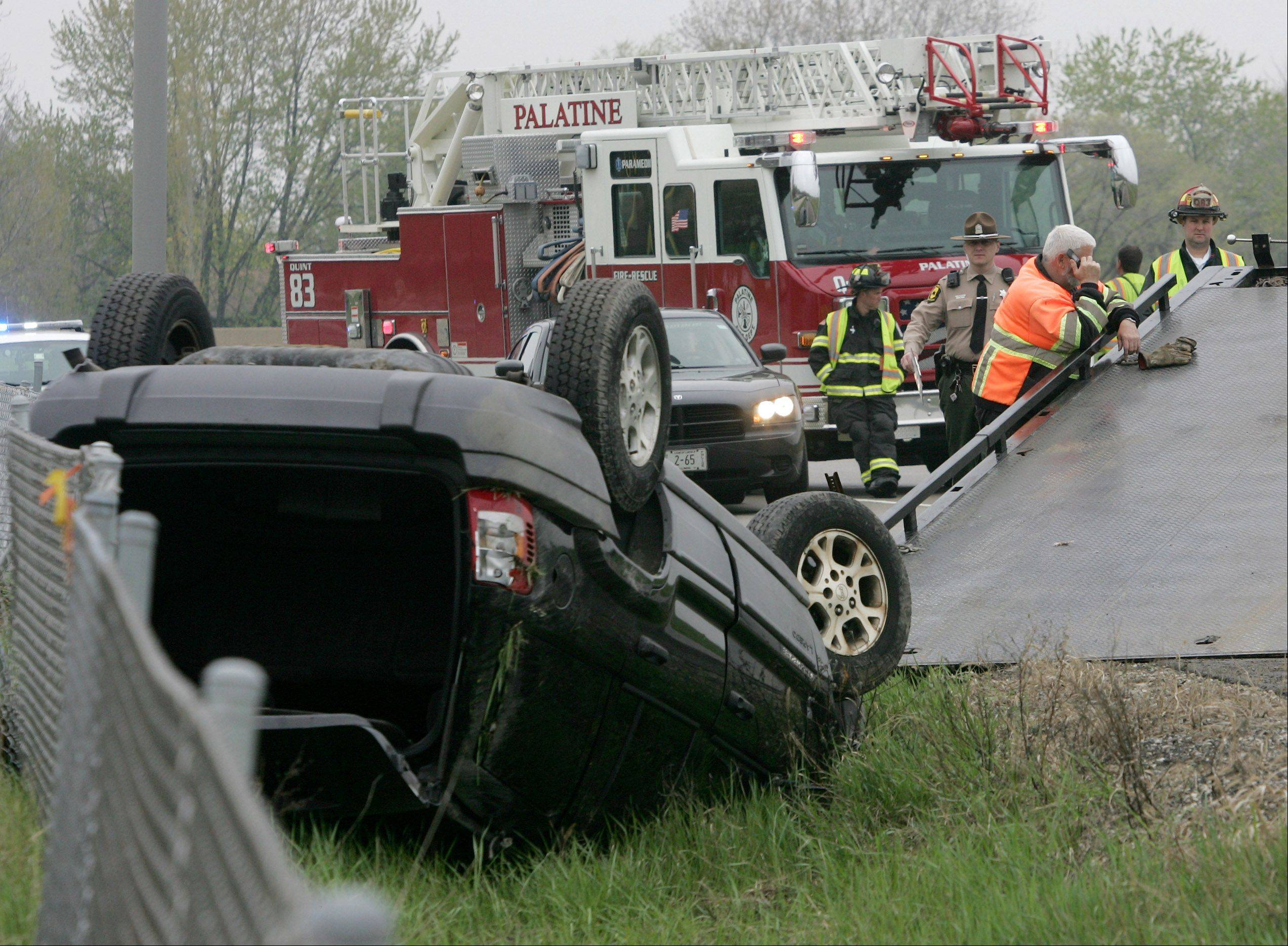 The Palatine Fire Department and Illinois State Police responded to a rollover accident Sunday involving a Jeep Grand Cherokee as it exited onto the eastbound ramp to Palatine Road from northbound Route 53 in Palatine. Bob Caputo of A-Express Towing in Kildeer tries to flip the vehicle as it is removed from the scene.