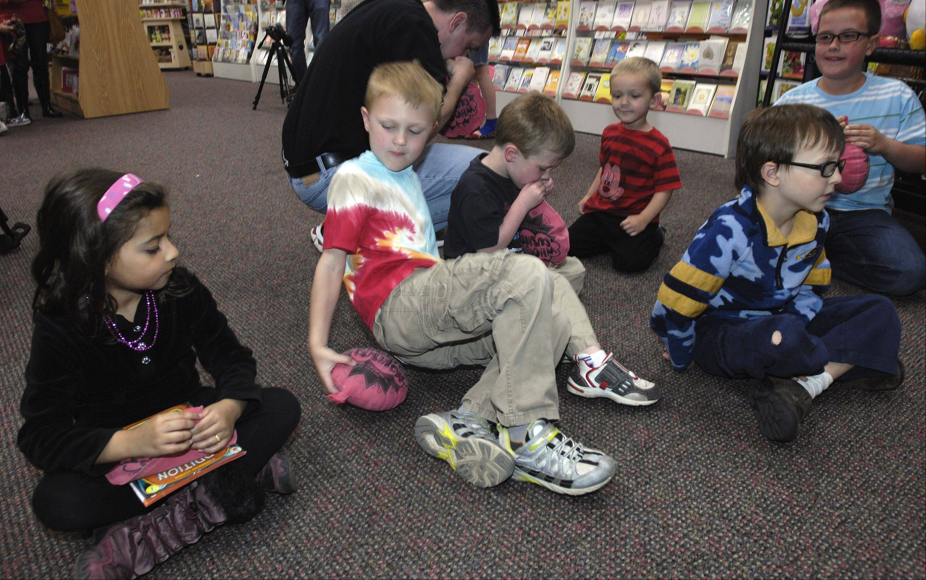 "Kids ready their whoopee cushions for ""The Great Whoop Off"" to celebrate the latest release of a new book in the Horrid Henry series, at Anderson's Bookshop in Naperville."