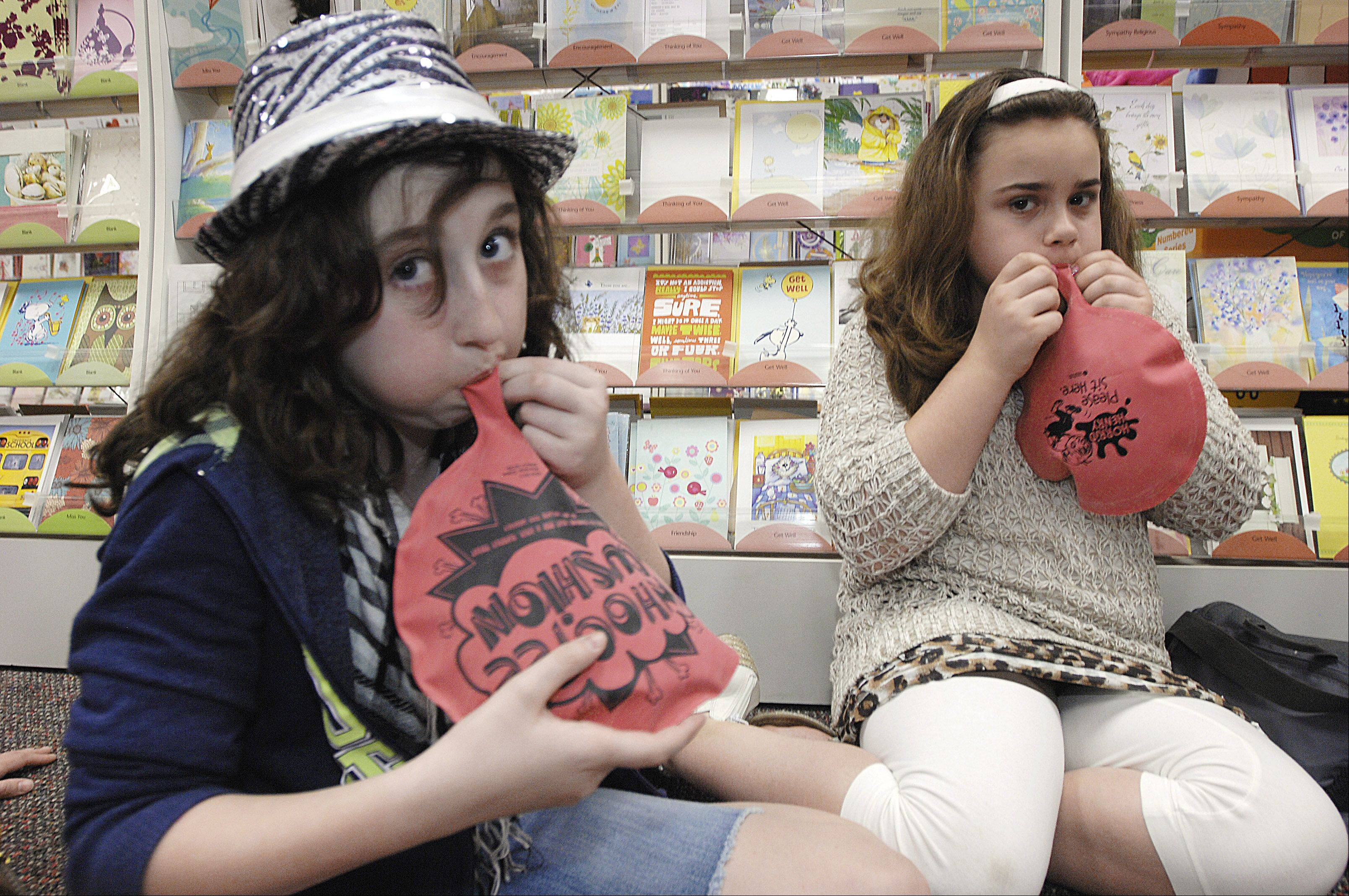 "Molly Lucas, 10 and Samantha Slepicka, 10 of Bollingbrook ready their whoopee cushions for ""The Great Whoop Off"" to celebrate the latest release of a new book in the Horrid Henry series, at Anderson's Bookshop in Naperville."