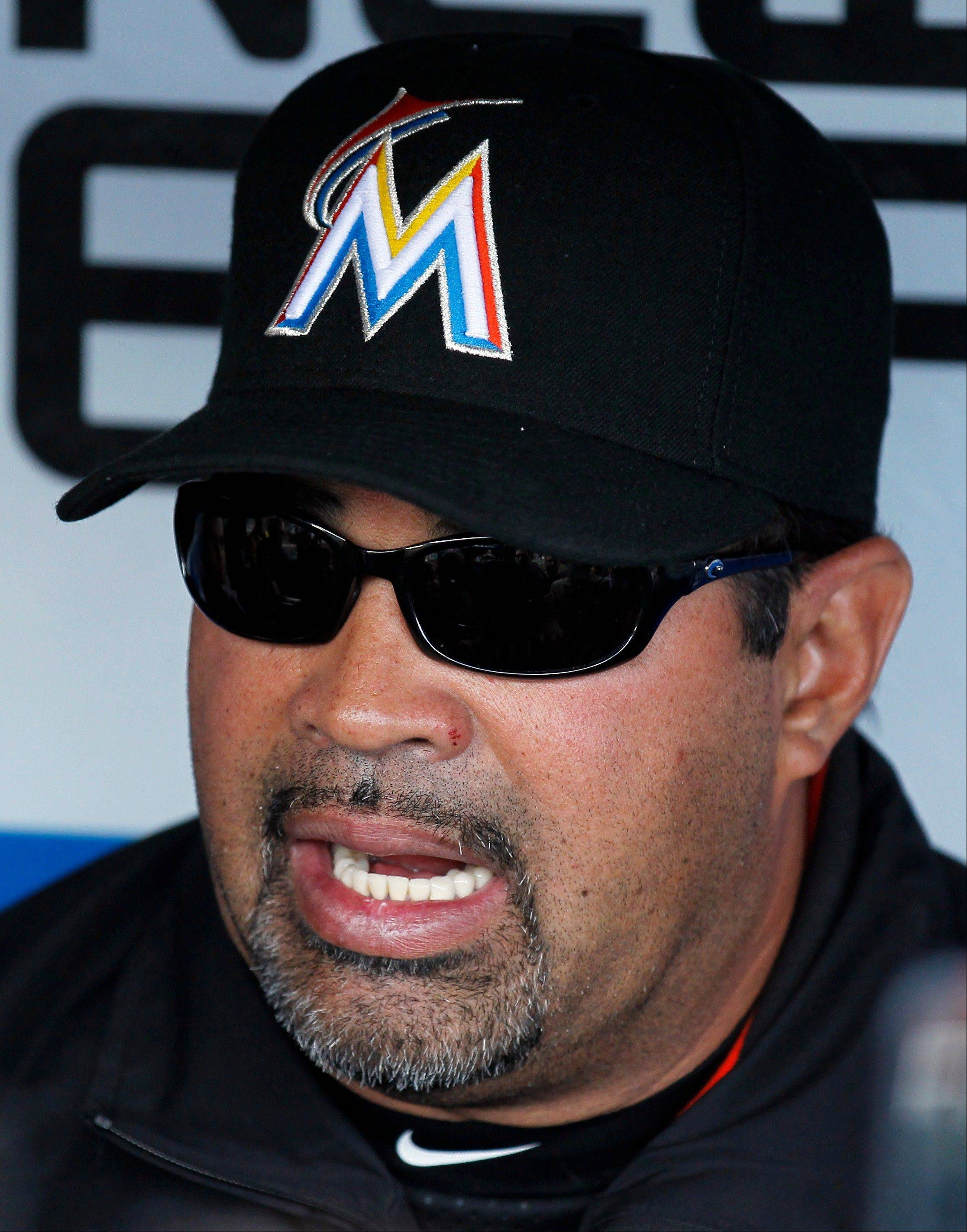 Miami Marlins manager Ozzie Guillen talks with the media before the Philiadelphia Phillies home opener baseball game, Monday, April 9, 2012, in Philadelphia.