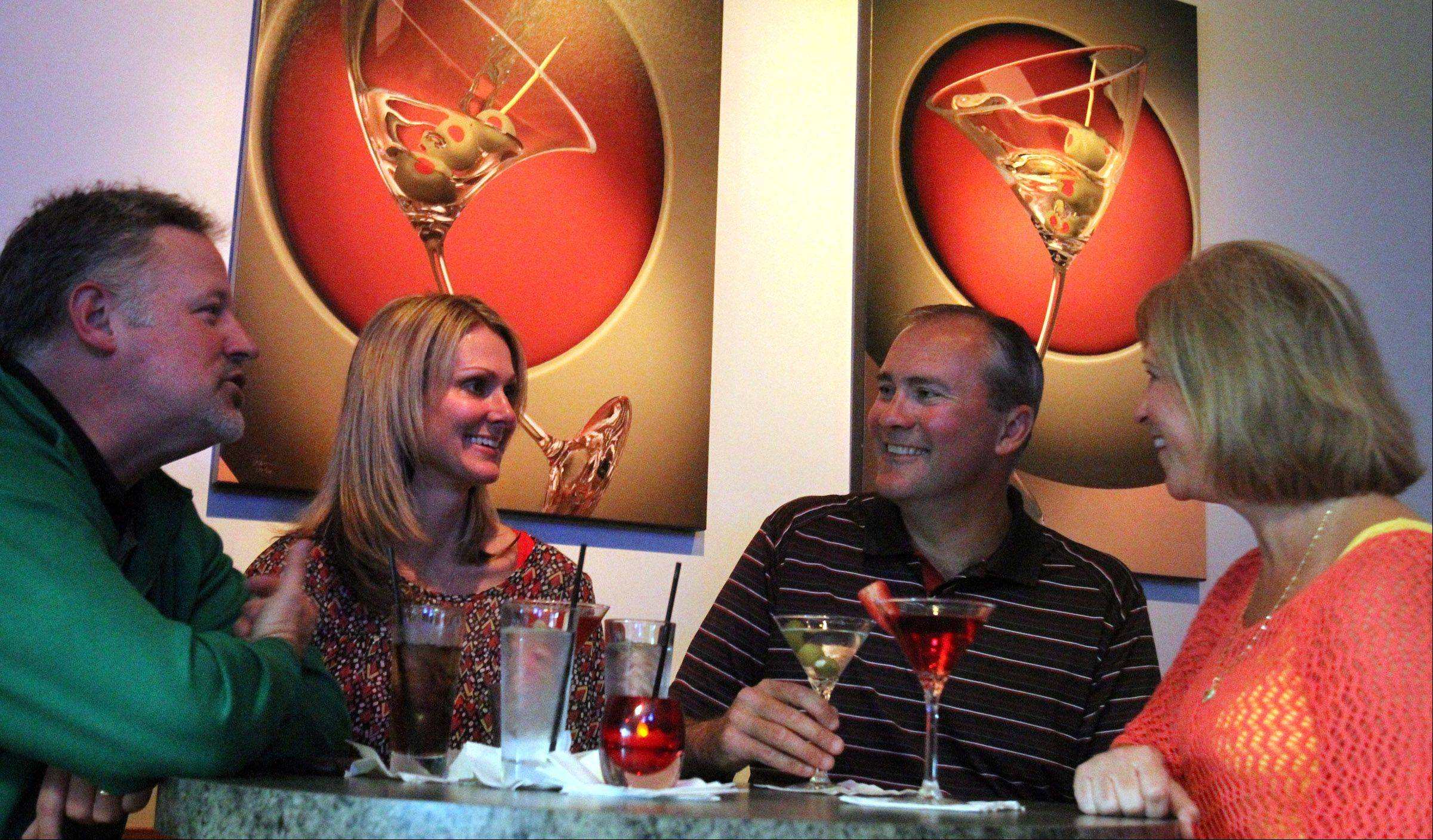 Chris and Gina Paluch, left, and Ken and Beth Edward, all of Hawthorn Woods, enjoy drinks at Strawberry Moon martini bar in Wauconda.