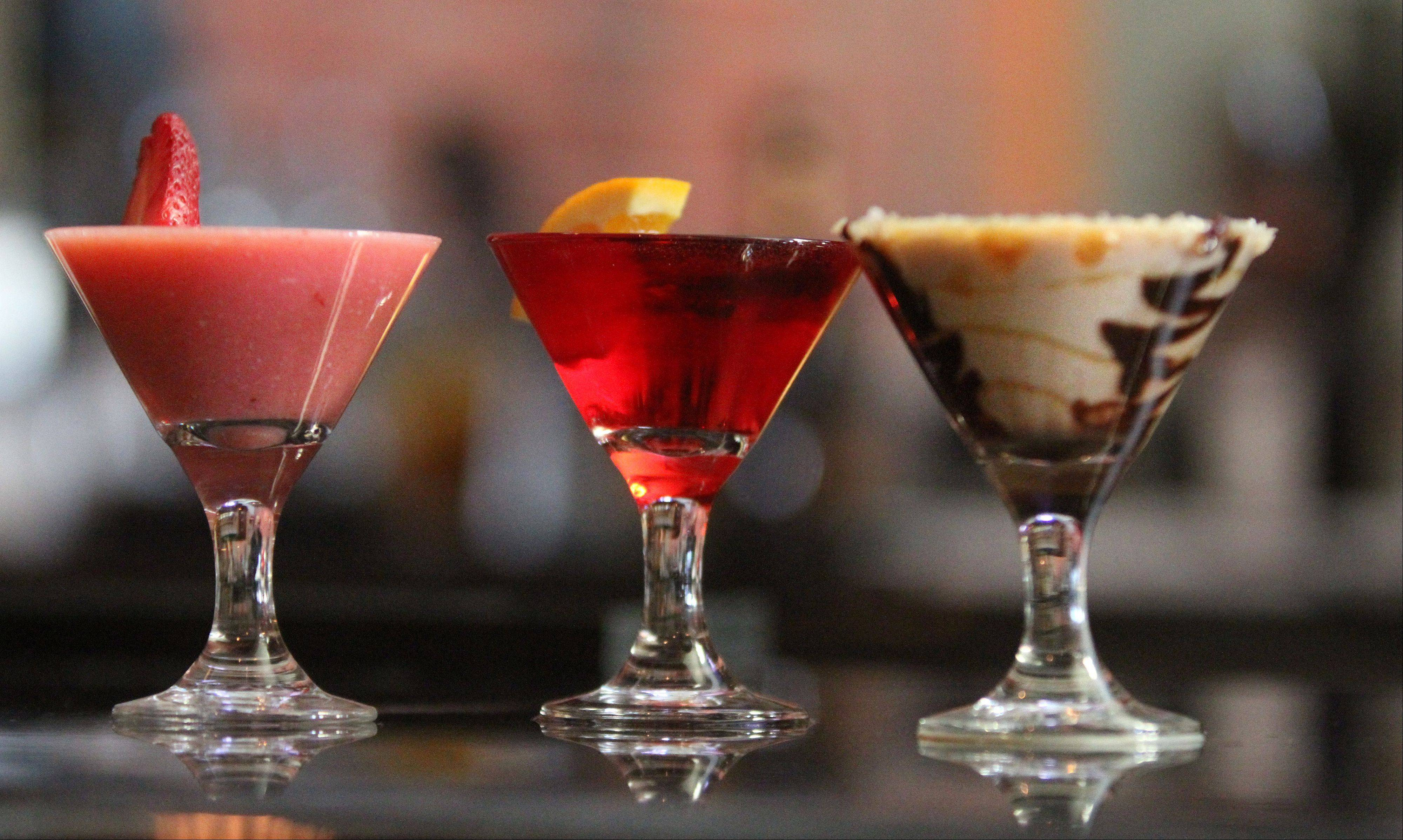 The signature Strawberry Moon, left, pomegranate and salt-carmel-mocha martinis are among the sweet sippers at Strawberry Moon martini bar in Wauconda.