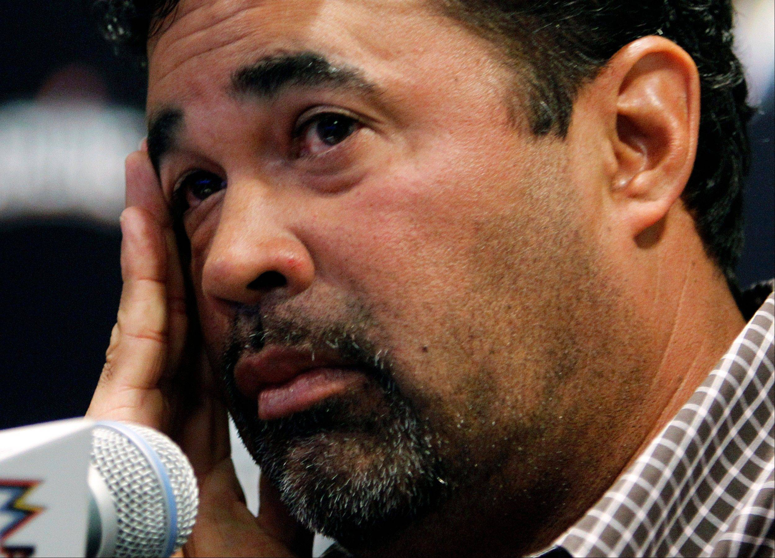 Associated PressMiami Marlins manager Ozzie Guillen listens to a question during a news conference at Marlins Stadium in Miami, Tuesday. April 10, 2012. Should Guillen be allowed freedom of speech like everybody else unless it's somehow a violation of his contract?