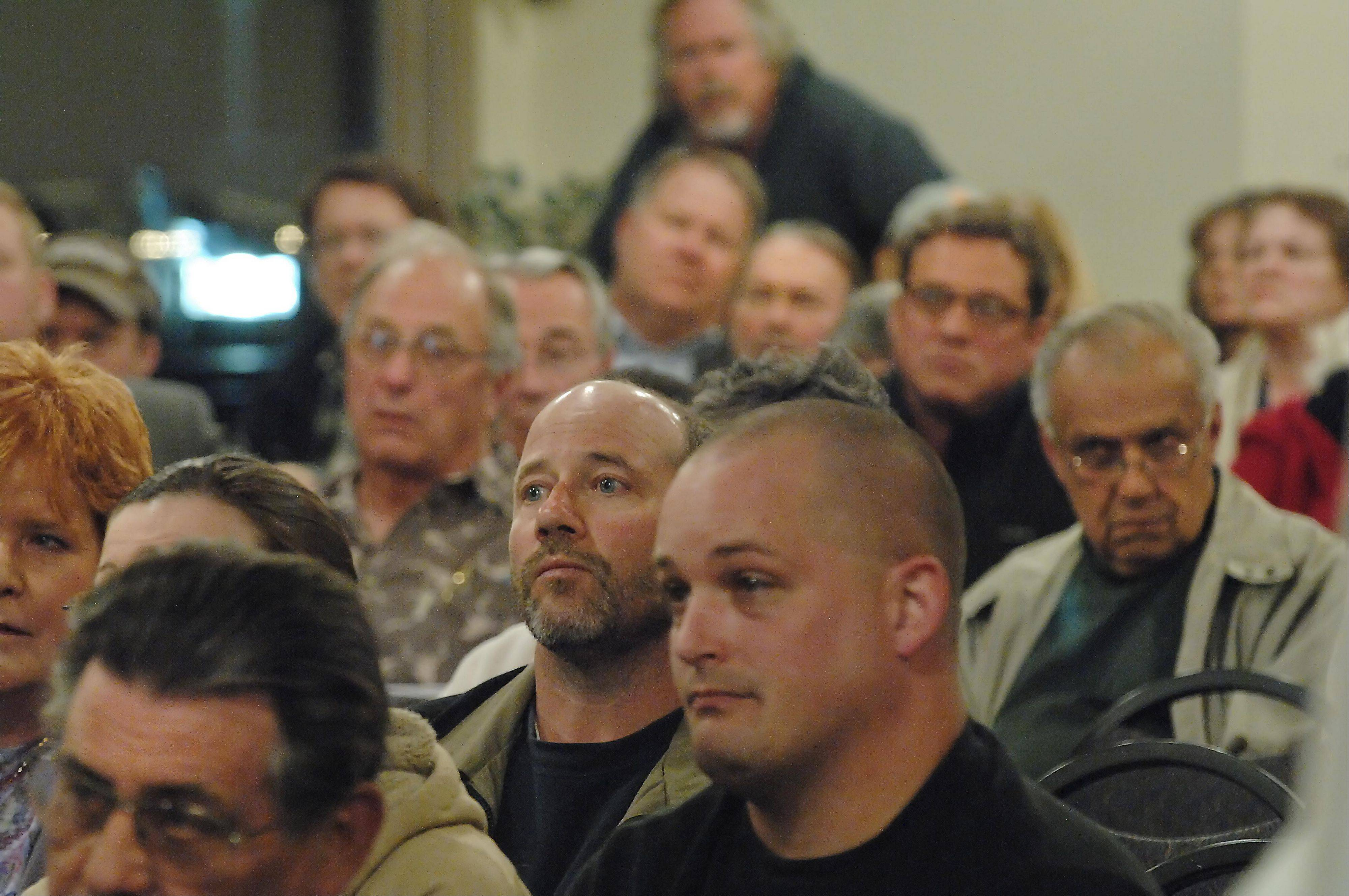Citizens listen with concern Tuesday night at the Dundee Township annual meeting. A vote was taken to continue deer culling in Dundee Township Open Spaces.
