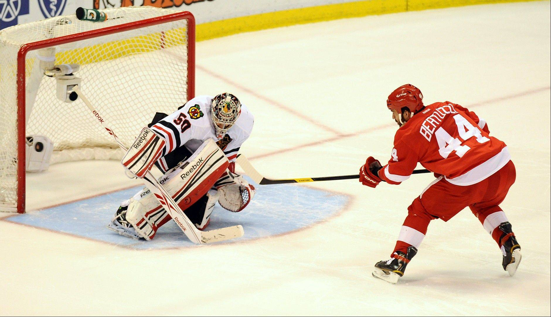 Detroit Red Wings right winger Todd Bertuzzi, right, is stymied by Blackhawks goalie Corey Crawford Saturday in an overtime shootout. The Blackhawks won 3-2 in a shootout.