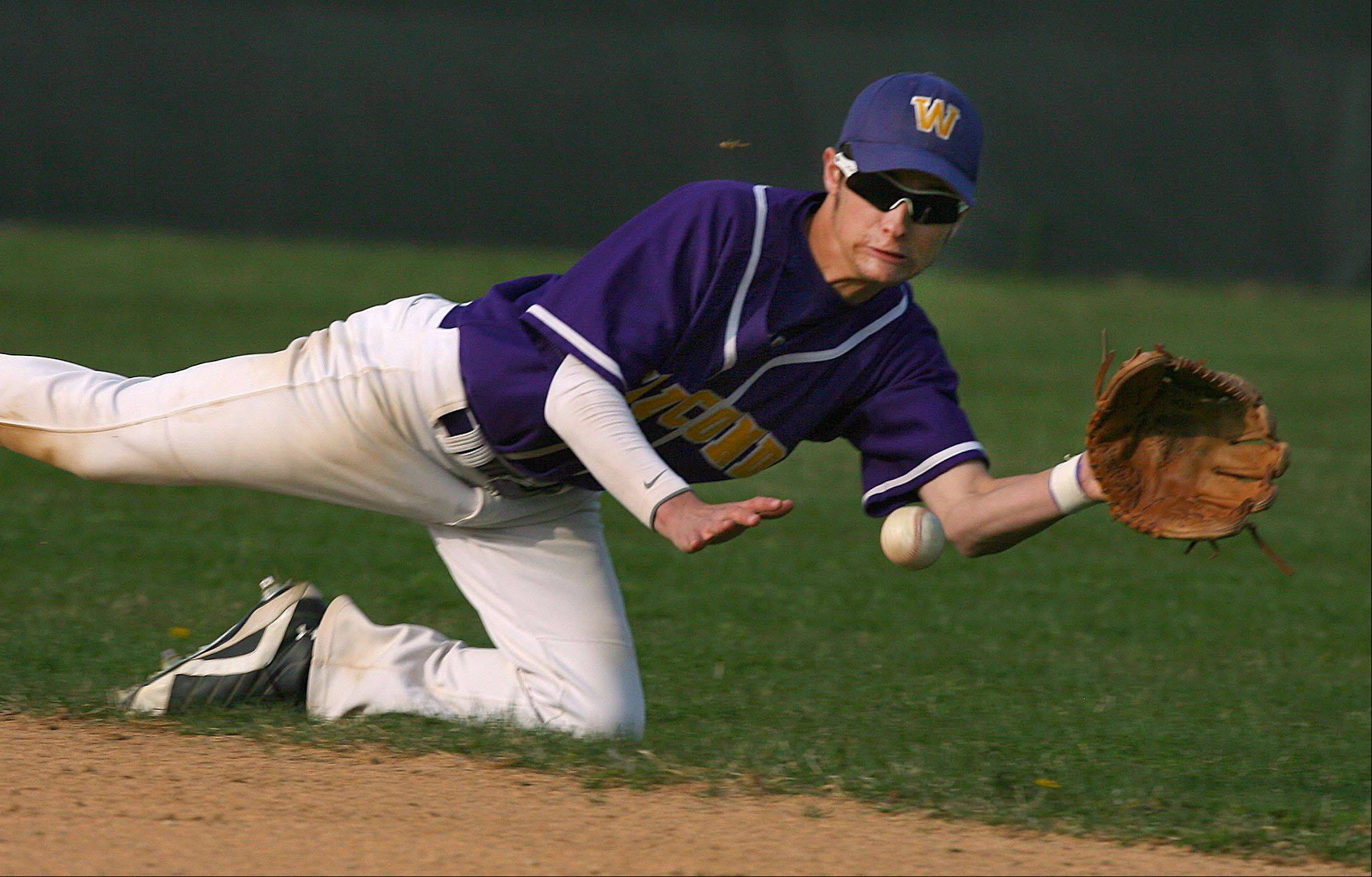 Wauconda's Tony Kaminsky makes a diving catch during Tuesday's baseball game in Wauconda.
