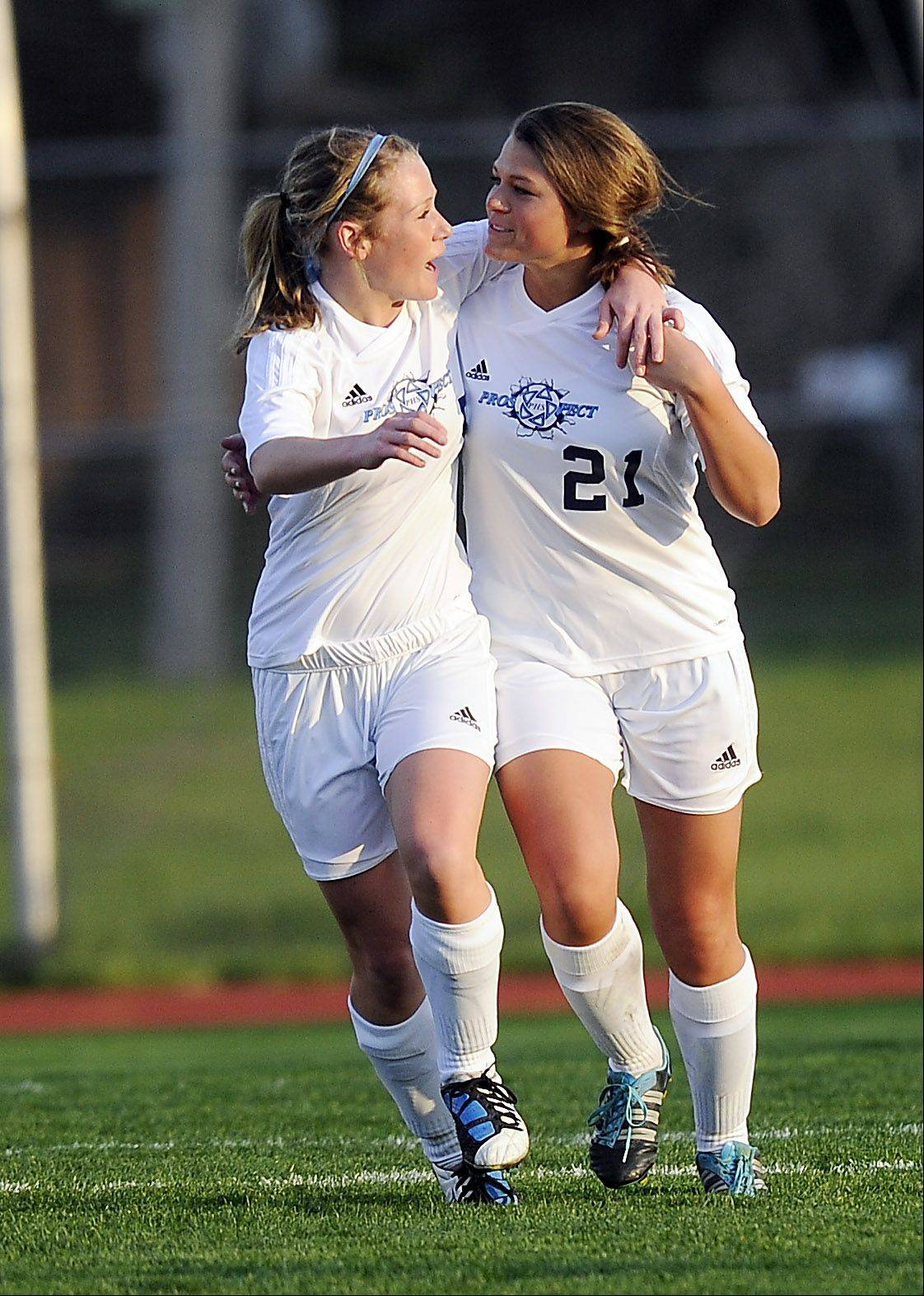 Prospect's Rachel Suarez, right, celebrates with teammate Taylor Smith after Suarez's goal during Monday's soccer game in Mount Prospect.