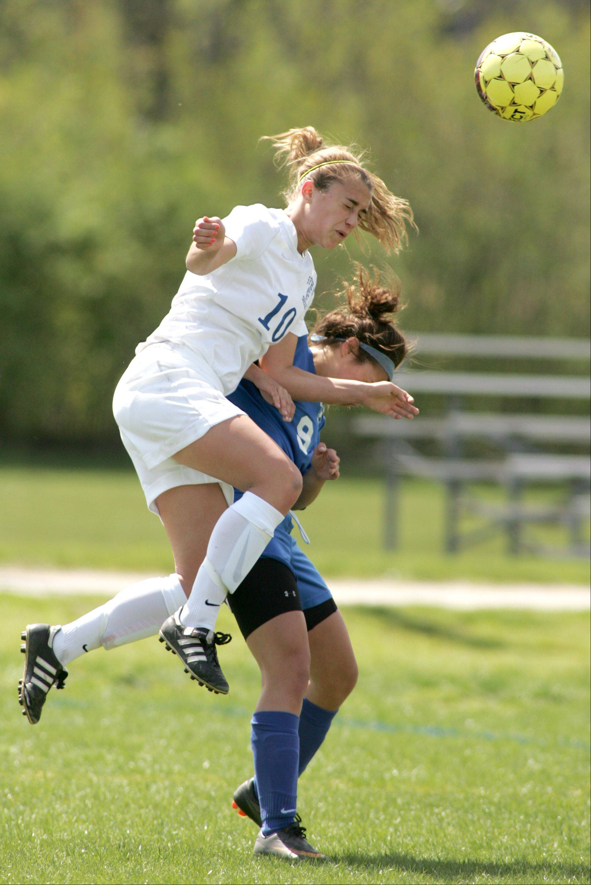 St. Francis's Amanda Gaggioli, left, battles Glenbard South's Danielle Pitaro during Saturday's girls soccer game.