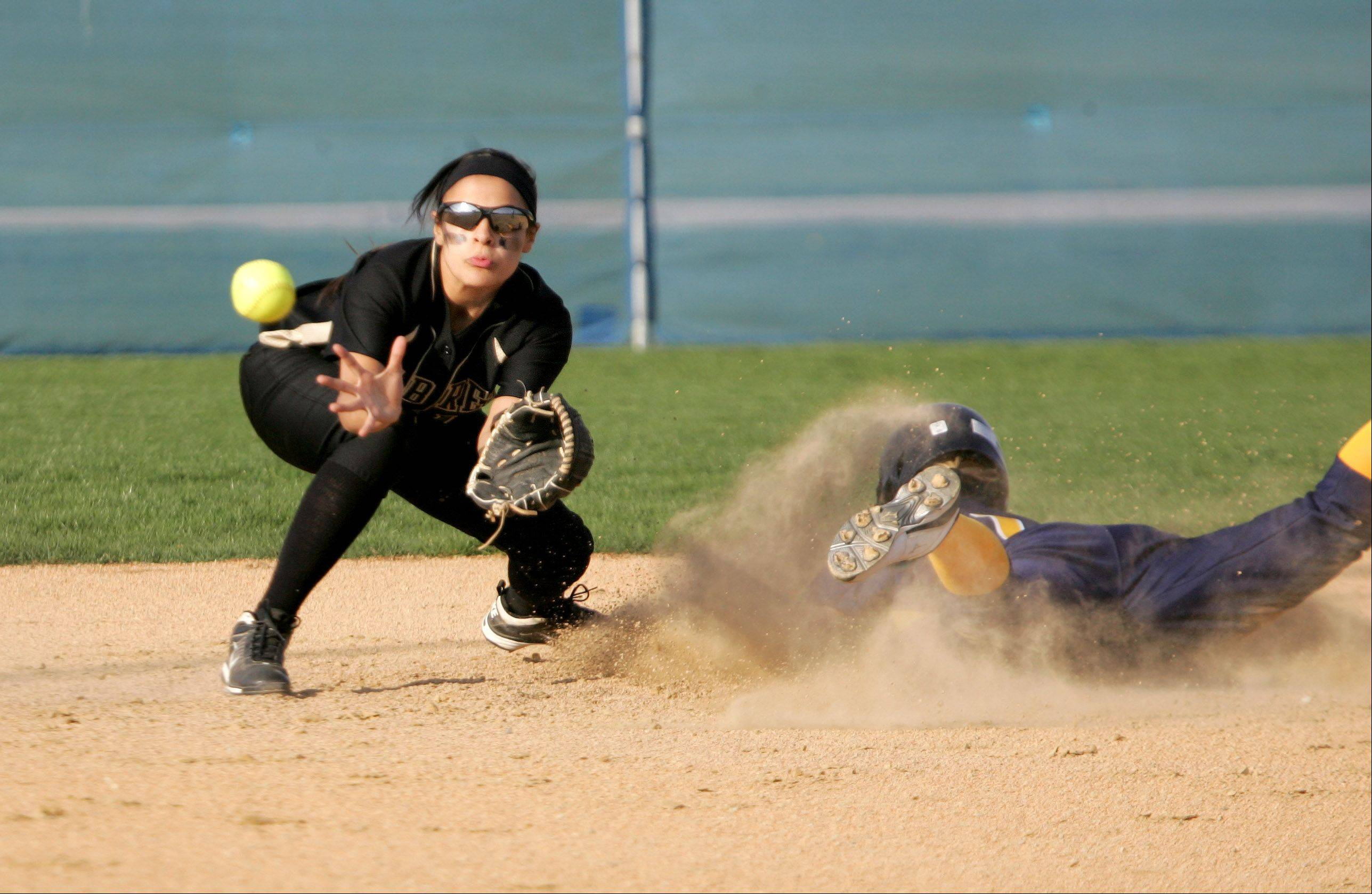Brittany Delao of Streamwood gets the ball, but Kat Widup of Neuqua Valley is safe after stealing Monday in Naperville.