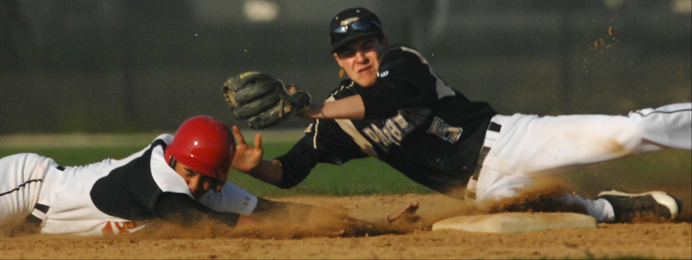 Batavia's Laren Eustace stretches to second ahead of Glenbard North shortstop Matt Albin Monday in Batavia.