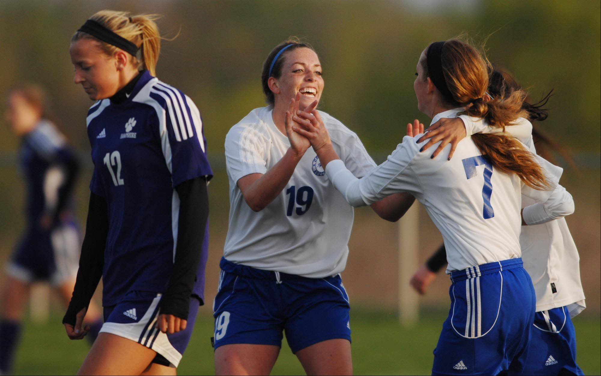 Burlington Central's Lindsey Puccio congratulates teammate Ellen Jayne after her goal as Hampshire's Natalie Starrenburg walks away Tuesday in Burlington.