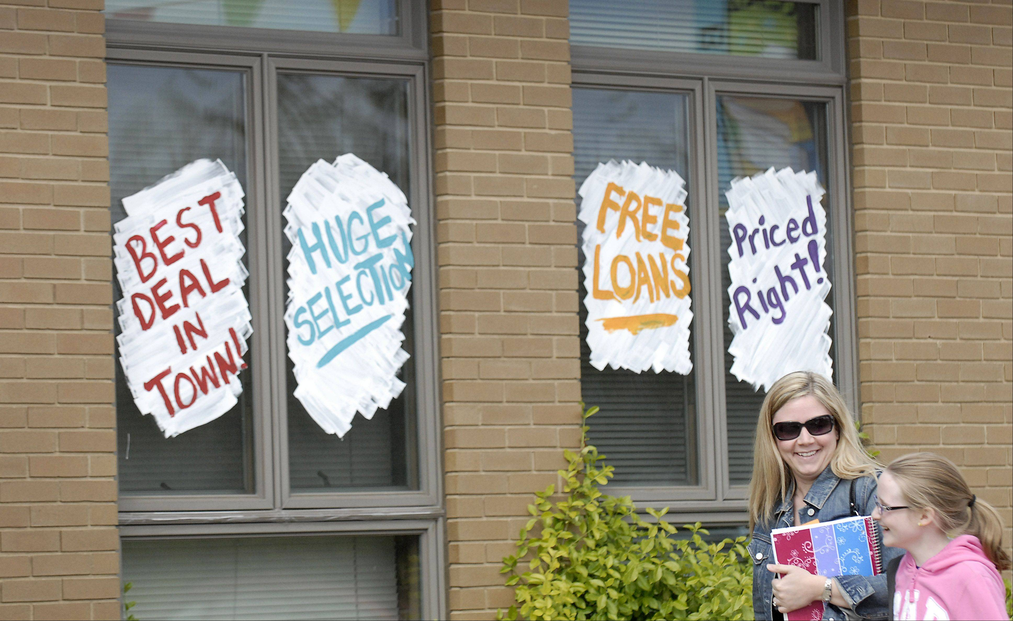 The Bartlett Public Library celebrates National Library Week this week, taking on the appearance of a car dealership to bring in patrons. Signs, window paintings, flags and even an inflatable gorilla on Bartlett Rd is being used to grab people's attention.