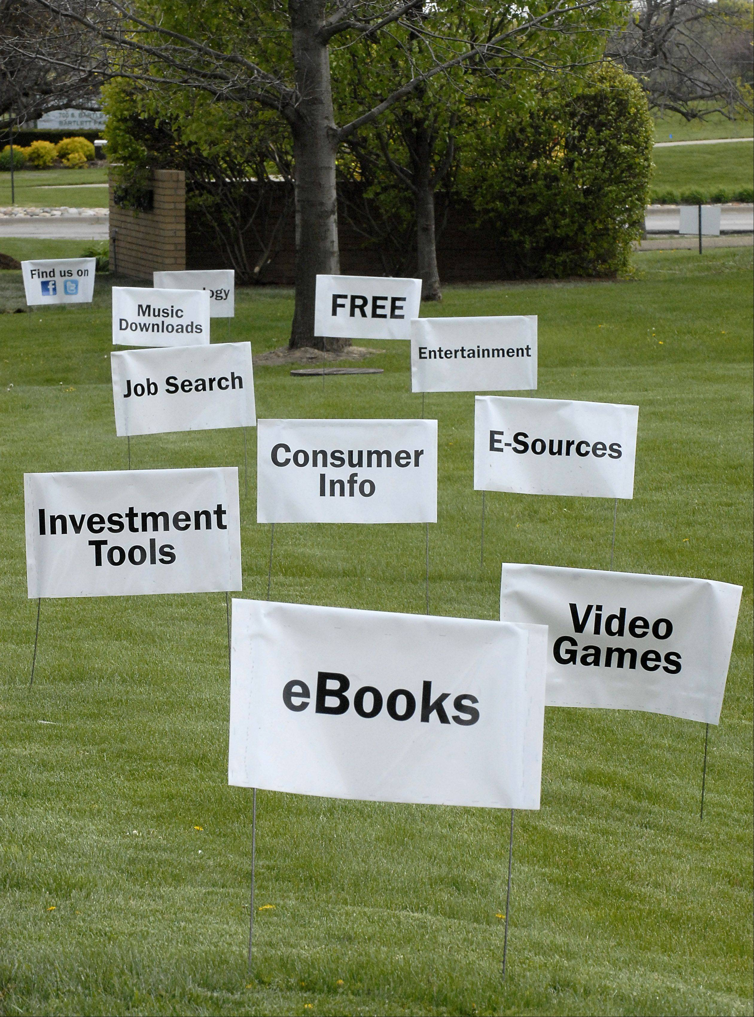 Signs dot the front lawn along Bartlett Road of the Bartlett Public Library as they celebrate National Library Week this week.