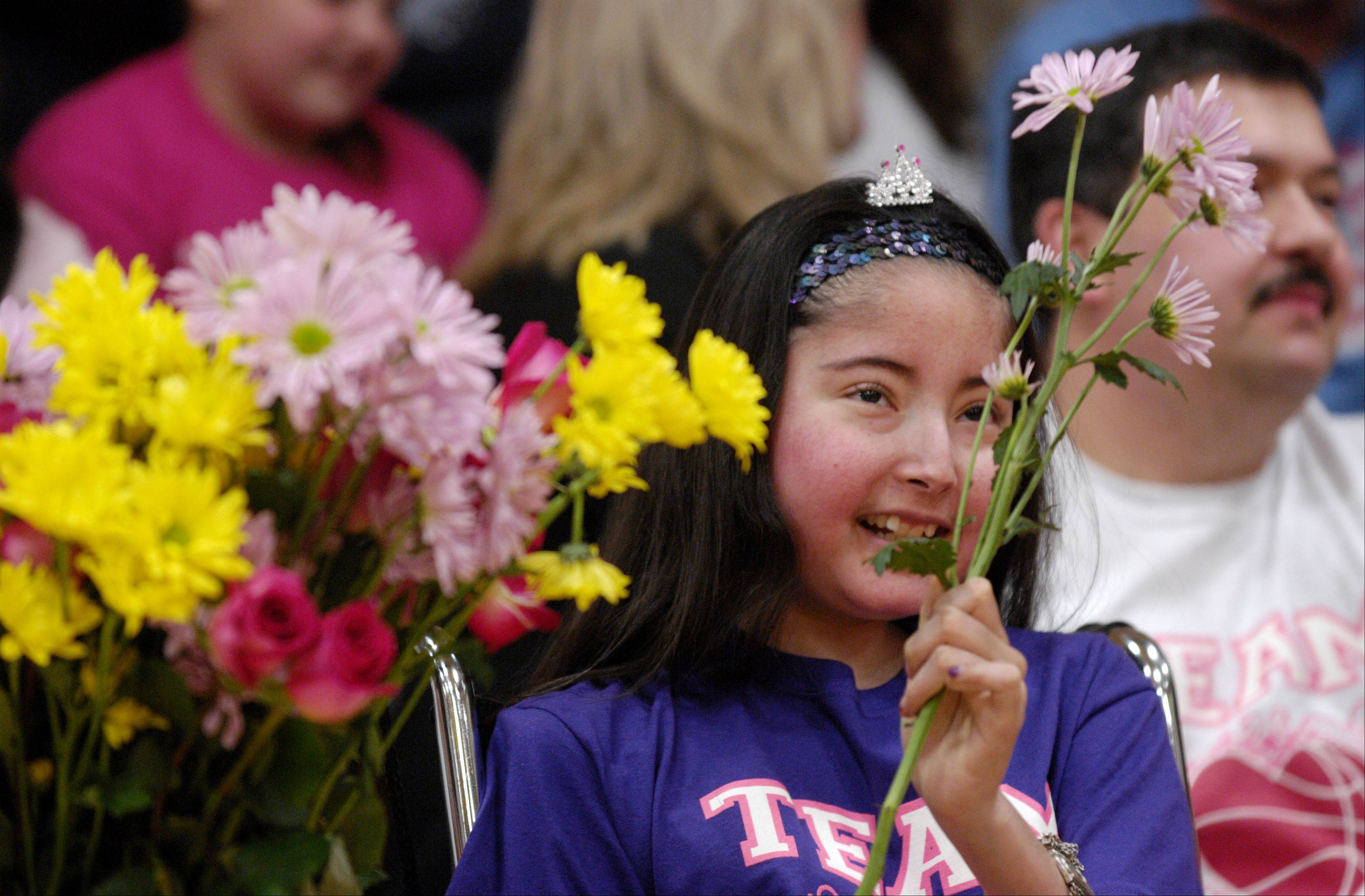 Blackhawk Middle School student Ashley Garza, 13, died from cancer Tuesday. Ashley collected flowers last month from Bensenville and Wood Dale moms who played a charity basketball game to help defray medical costs related to her treatment.