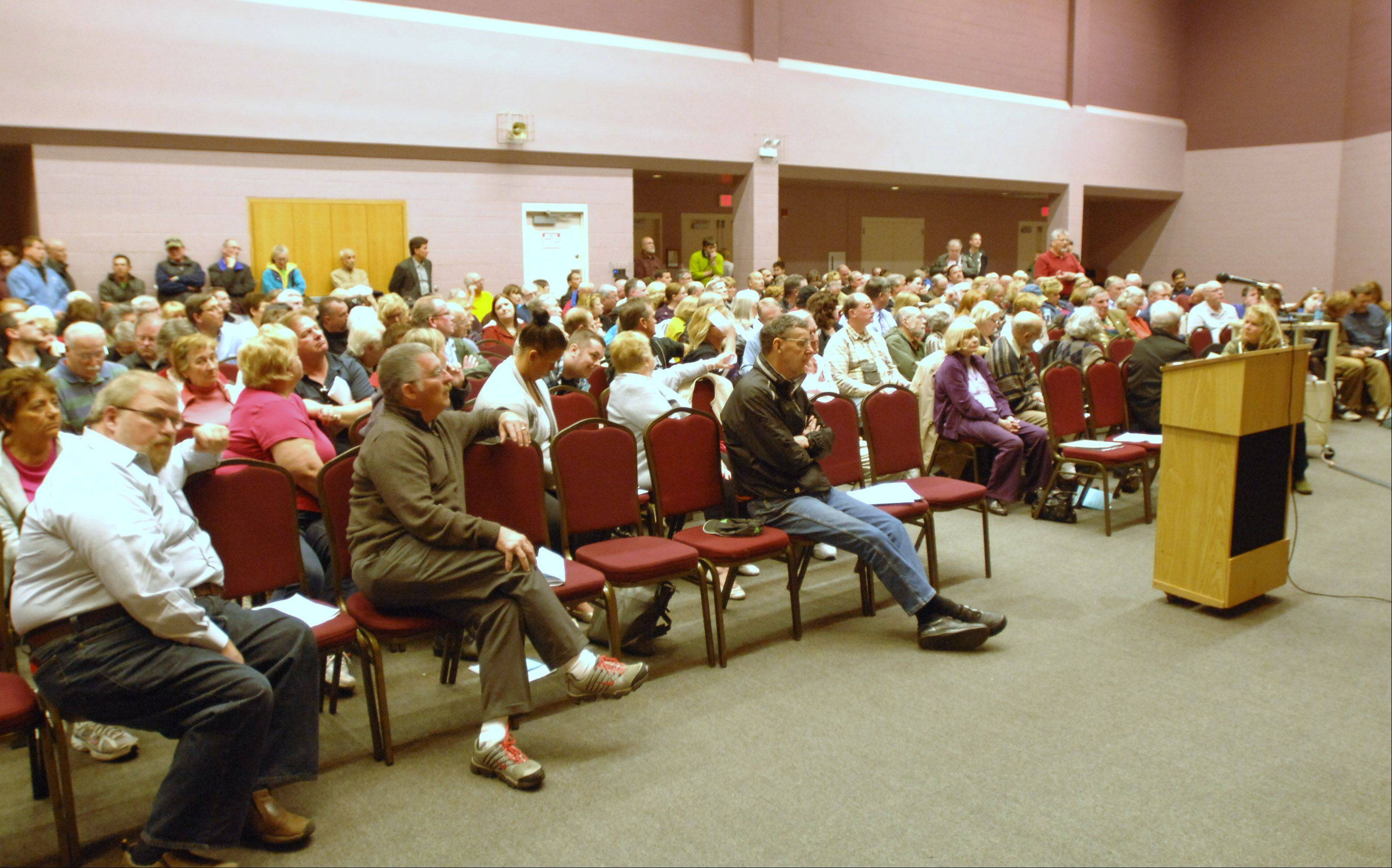 More than 250 concerned residents attend the Milton Township annual meeting Tuesday at the Wheaton Park District Community Center.