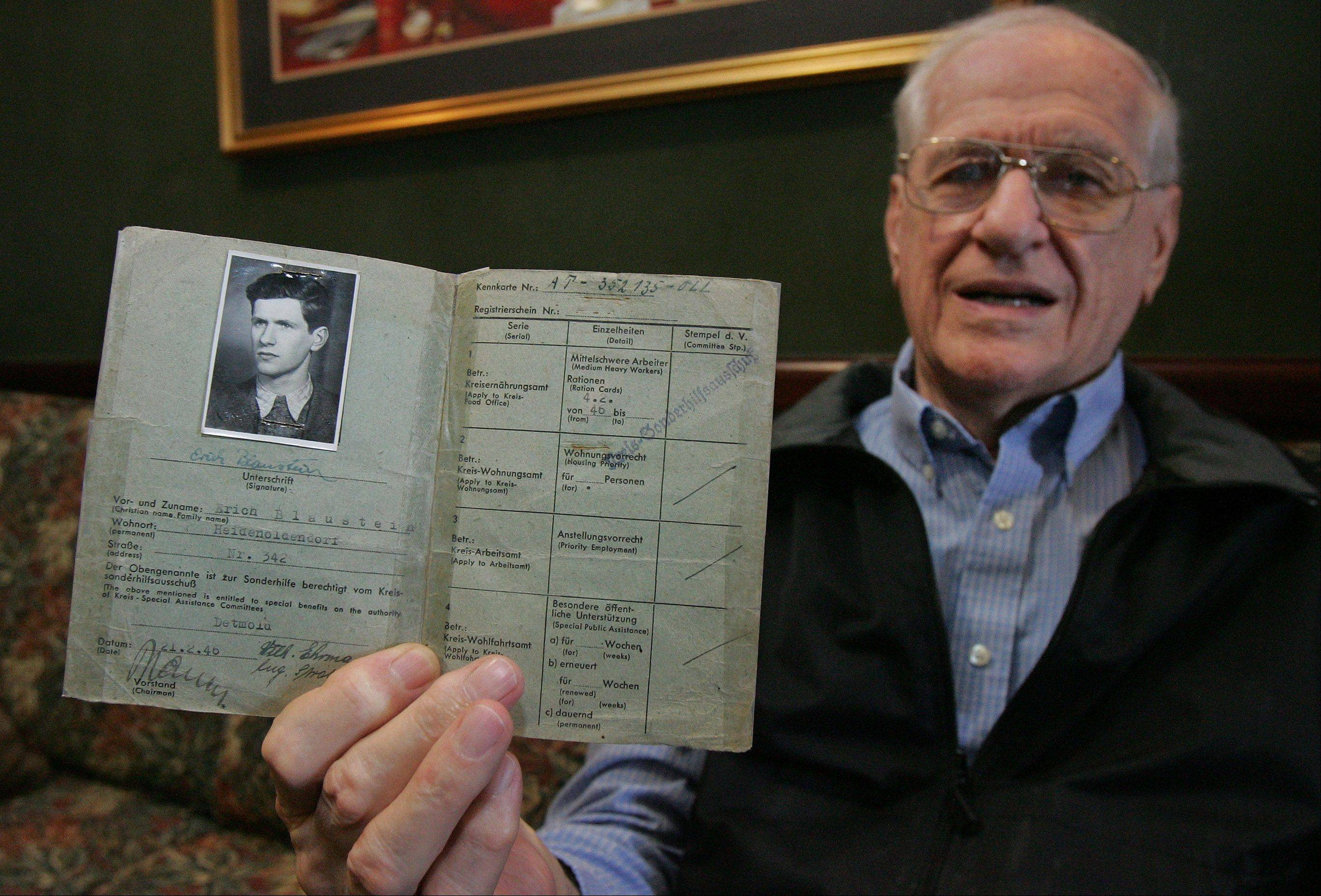 Holocaust survivor Eric Blaustein of Vernon Hills shows his German identification papers as he discusses his arrest at 17 by the Nazis and his time in Buchenwald prison camp during World War II. Blaustein will speak today at Harper College about his ordeal.
