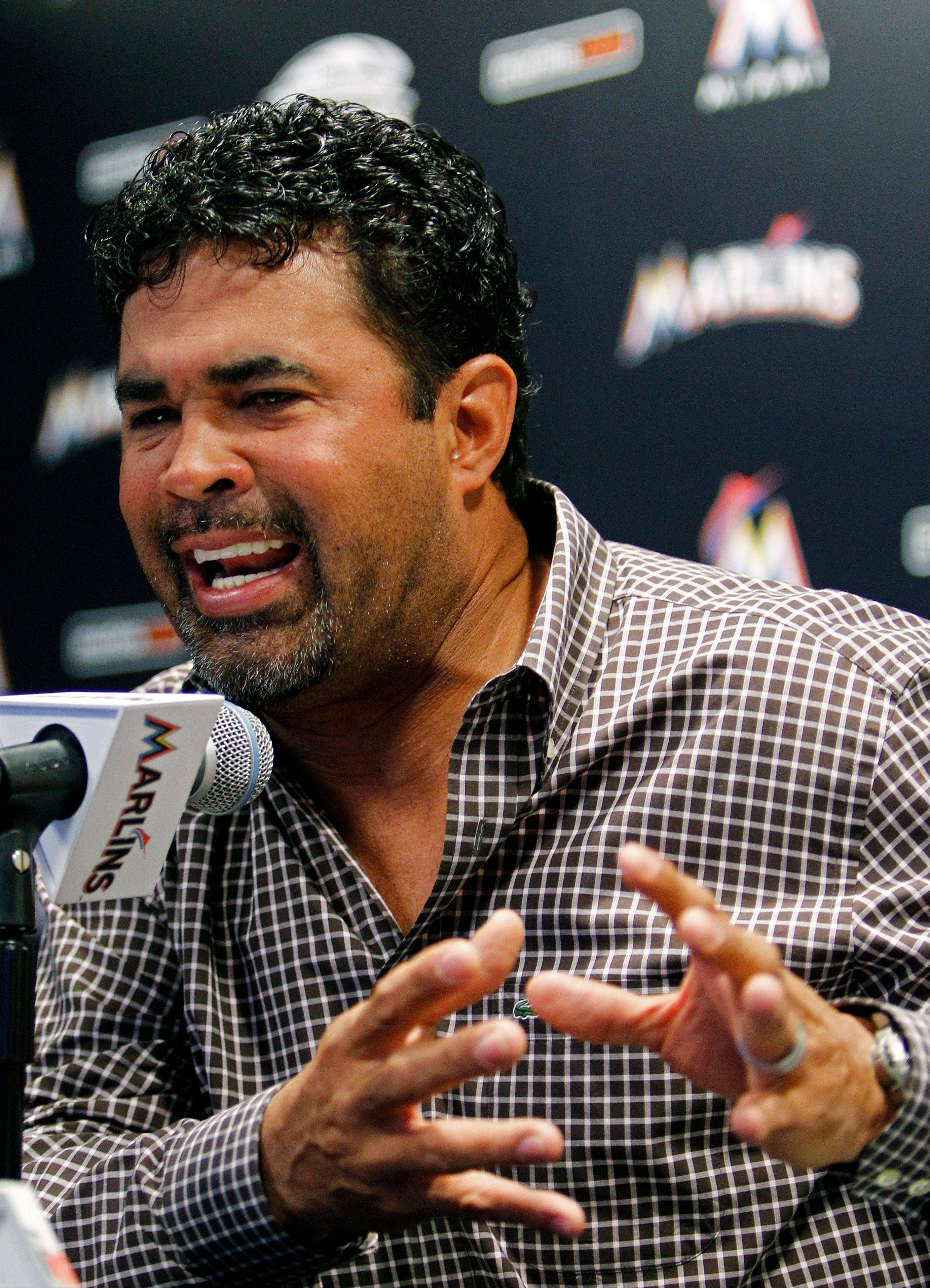 Miami Marlins manager Ozzie Guillen gestures at a news conference at the Marlins Stadium in Miami on Tuesday. Guillen was suspended for five games Tuesday because of his comments about Fidel Castro.