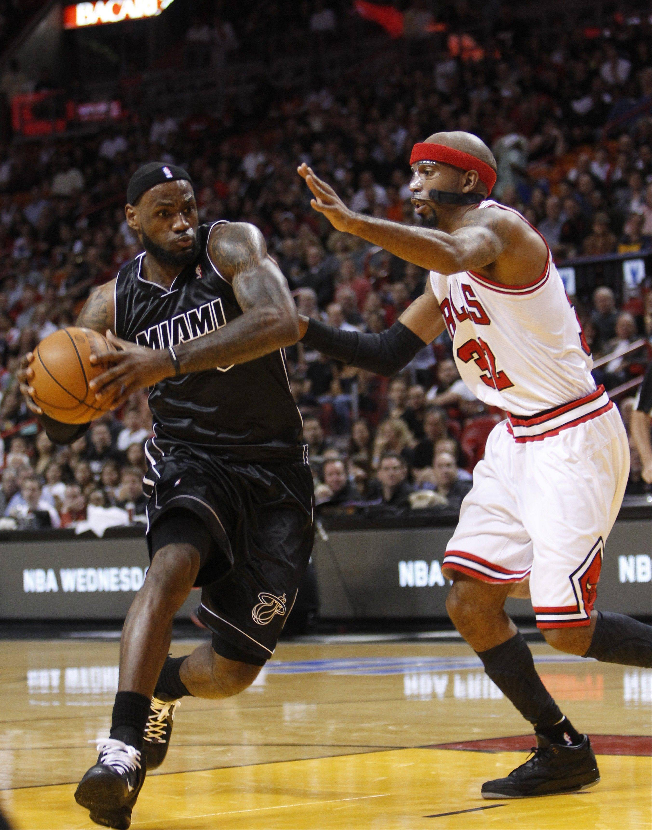 LeBron James, left, drives to the basket against guard Richard Hamilton on Jan. 29, 2012.