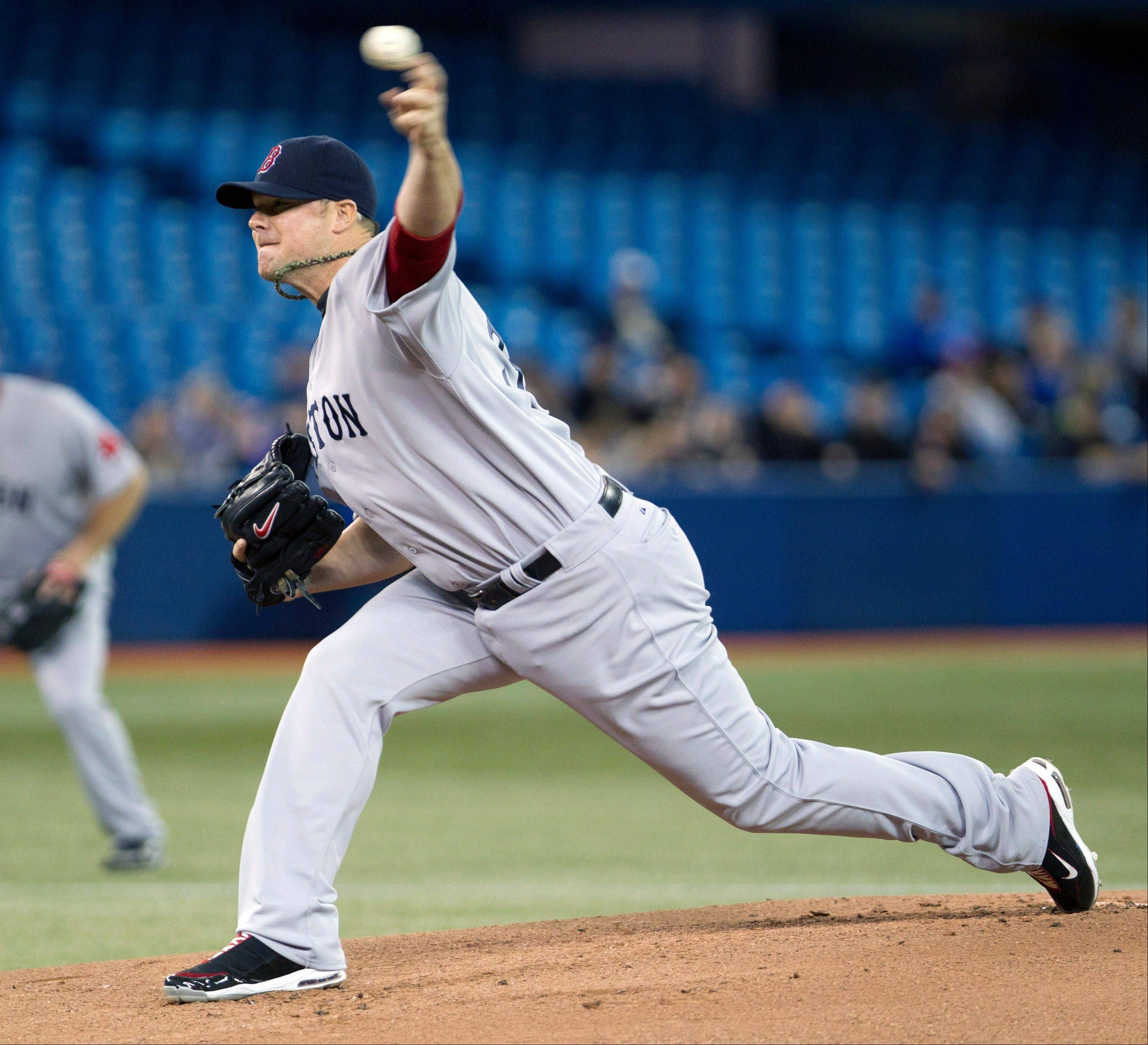 Boston Red Sox starting pitcher Jon Lester throws against the Toronto Blue Jays in first inning of a baseball game in Toronto on Wednesday, April 11, 2012.