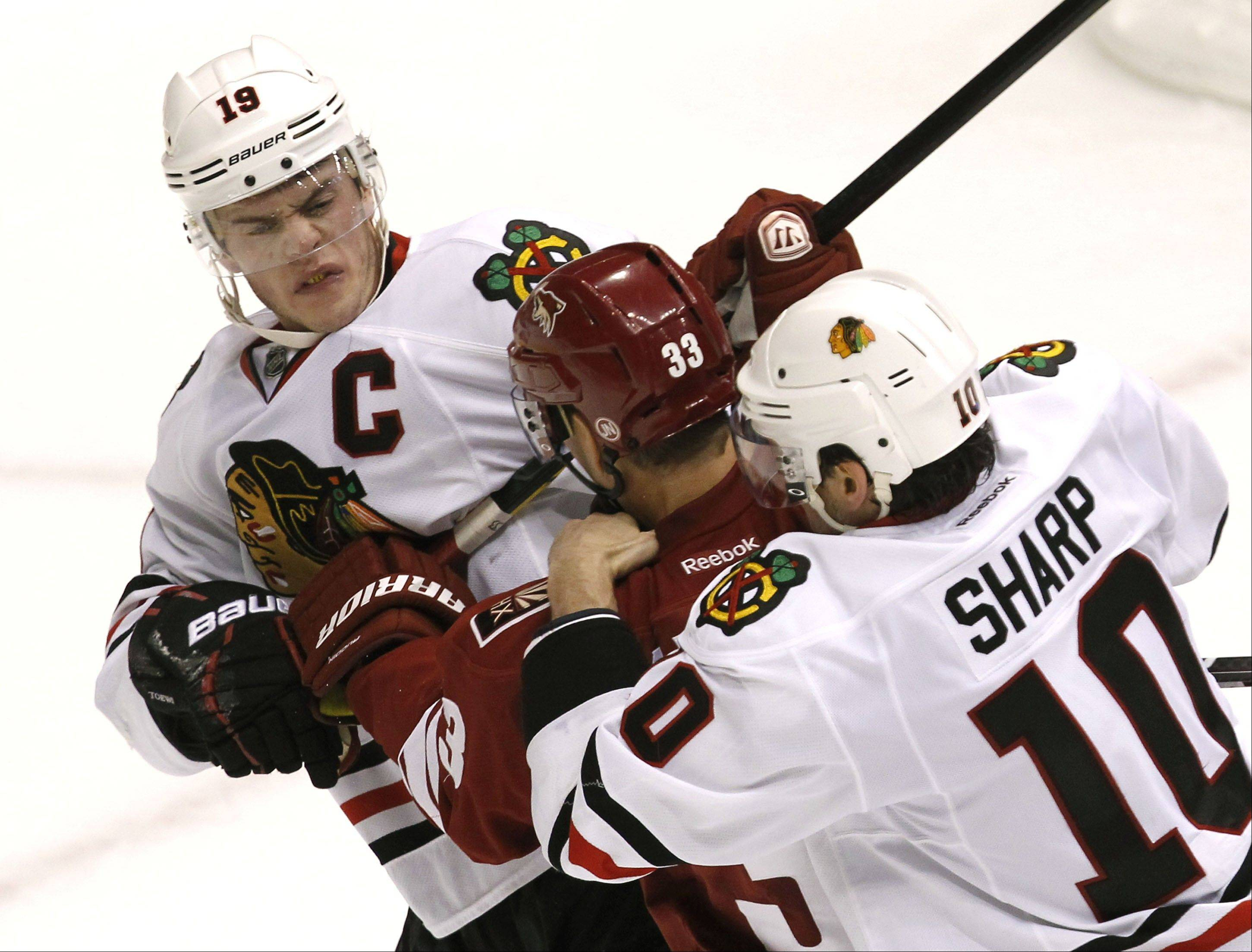In their Feb. 11 game in Arizona, Blackhawks captain onathan Toews scuffled with Phoenix Coyotes' Adrian Aucoin as teammate Patrick Sharp arrived to help Toews. The Coyotes blanked the Blackhawks 3-0.