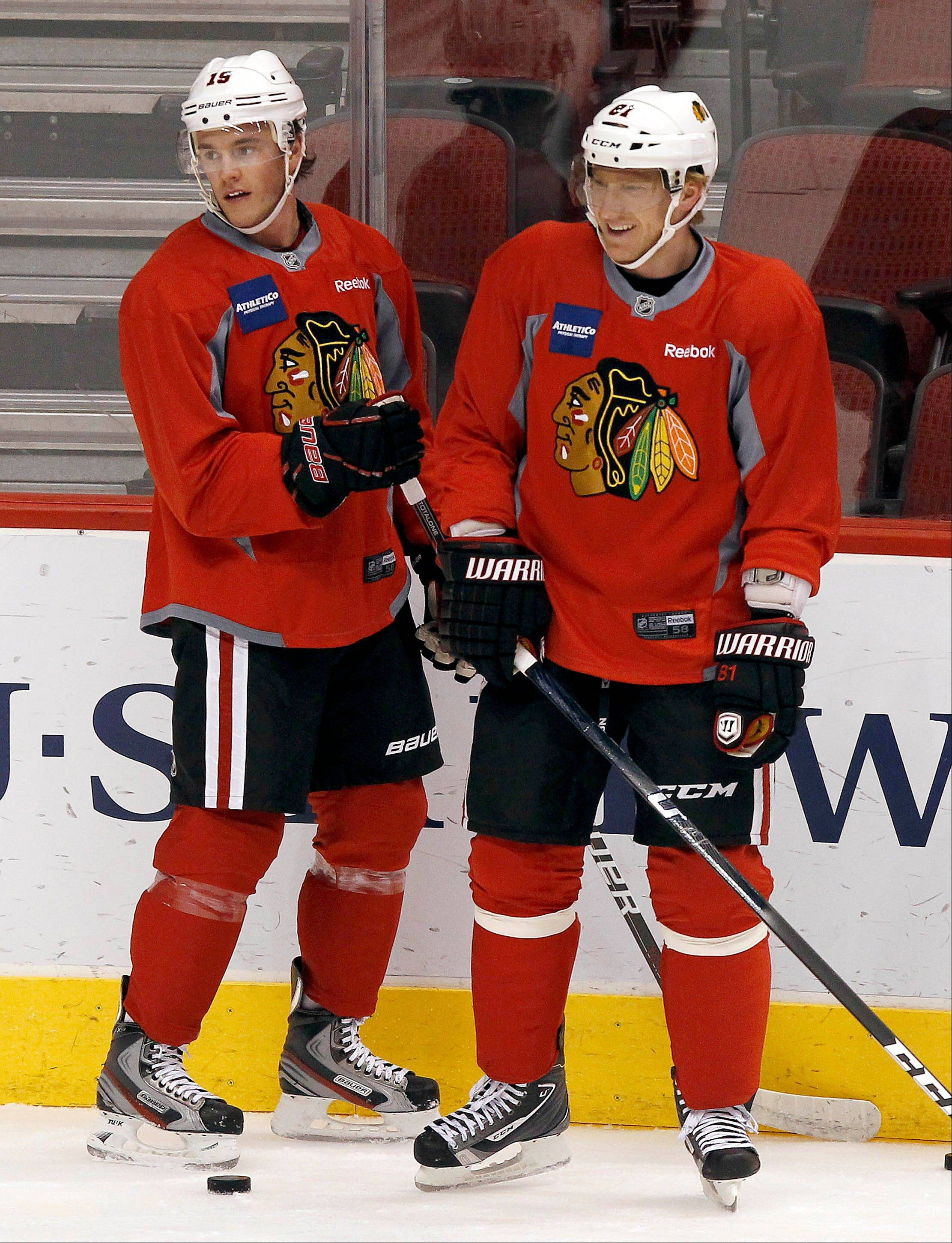 Jonathan Toews (19) and Marian Hossa (81) pause to chat during practice Wednesday in Glendale, Ariz. The Blackhawks and the Phoenix Coyotes are scheduled to play Game 1 of their Western Conference opening-round series Thursday.