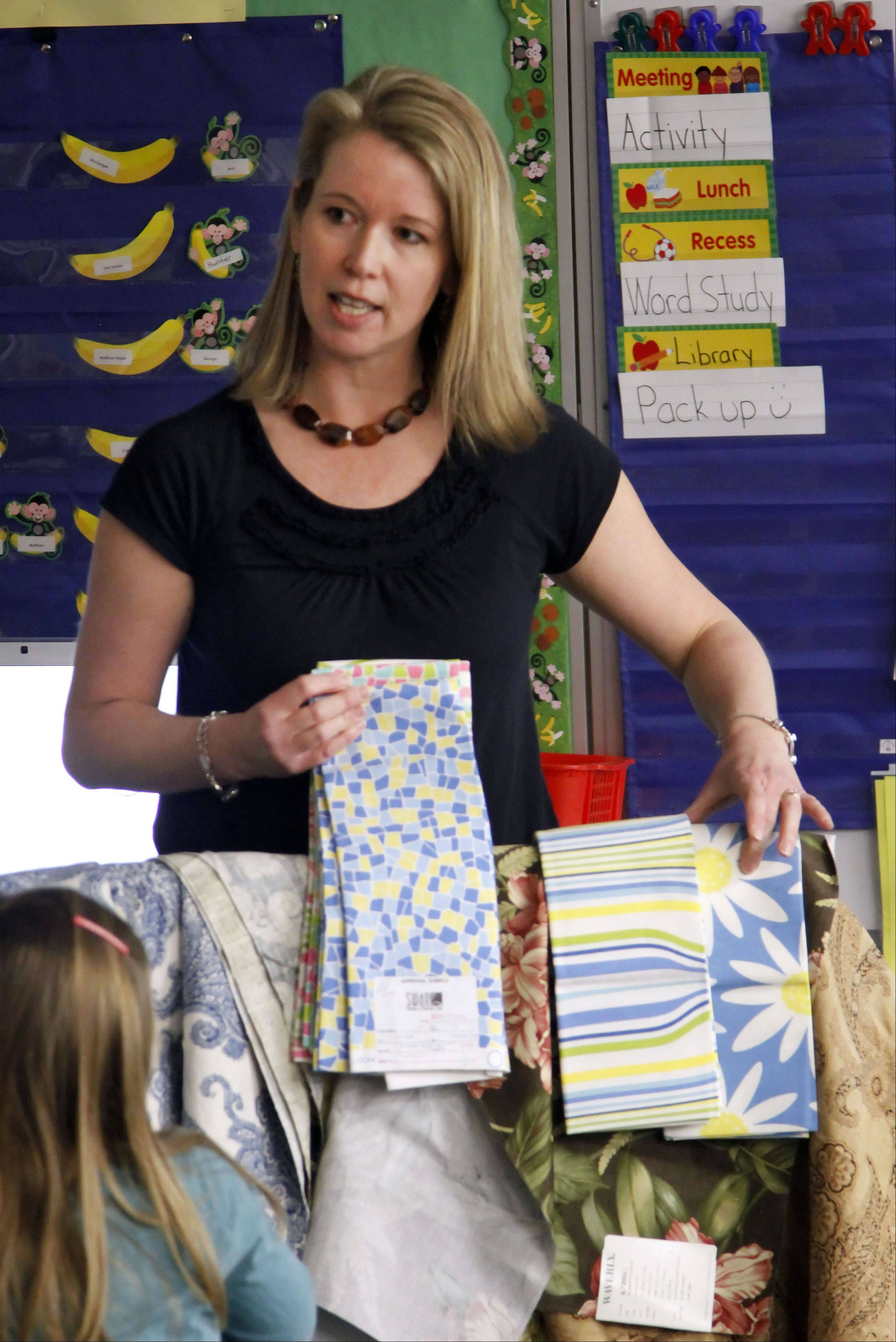 Textile designer Susan Krukonis of Libertyville shows examples of fabric designs during career day at Rockland School in Libertyville.