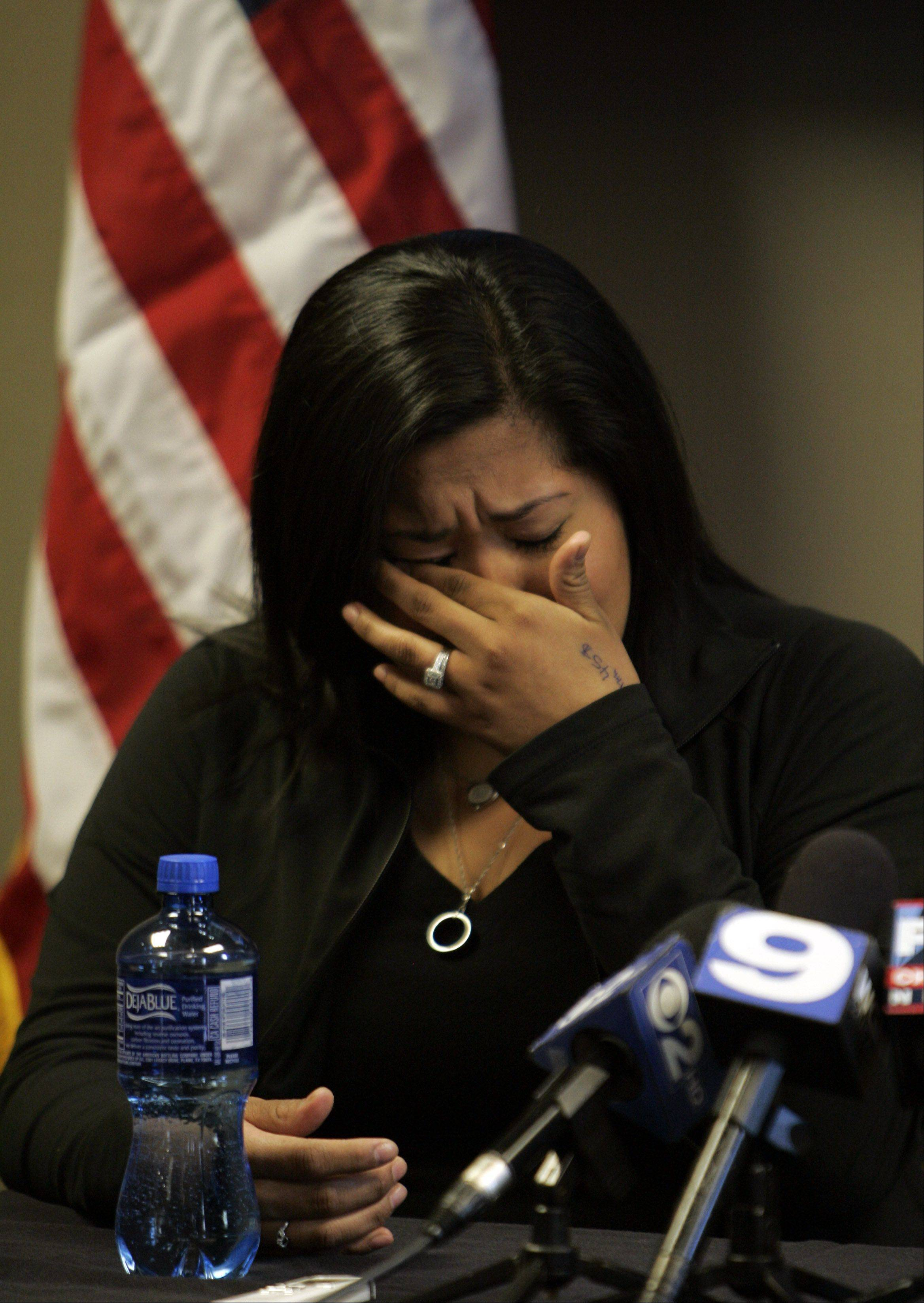 Julianna Martinez wipes away a tear as she remembers her husband Alex Martinez, a Marine from Elgin who was killed last week in Afghanistan.