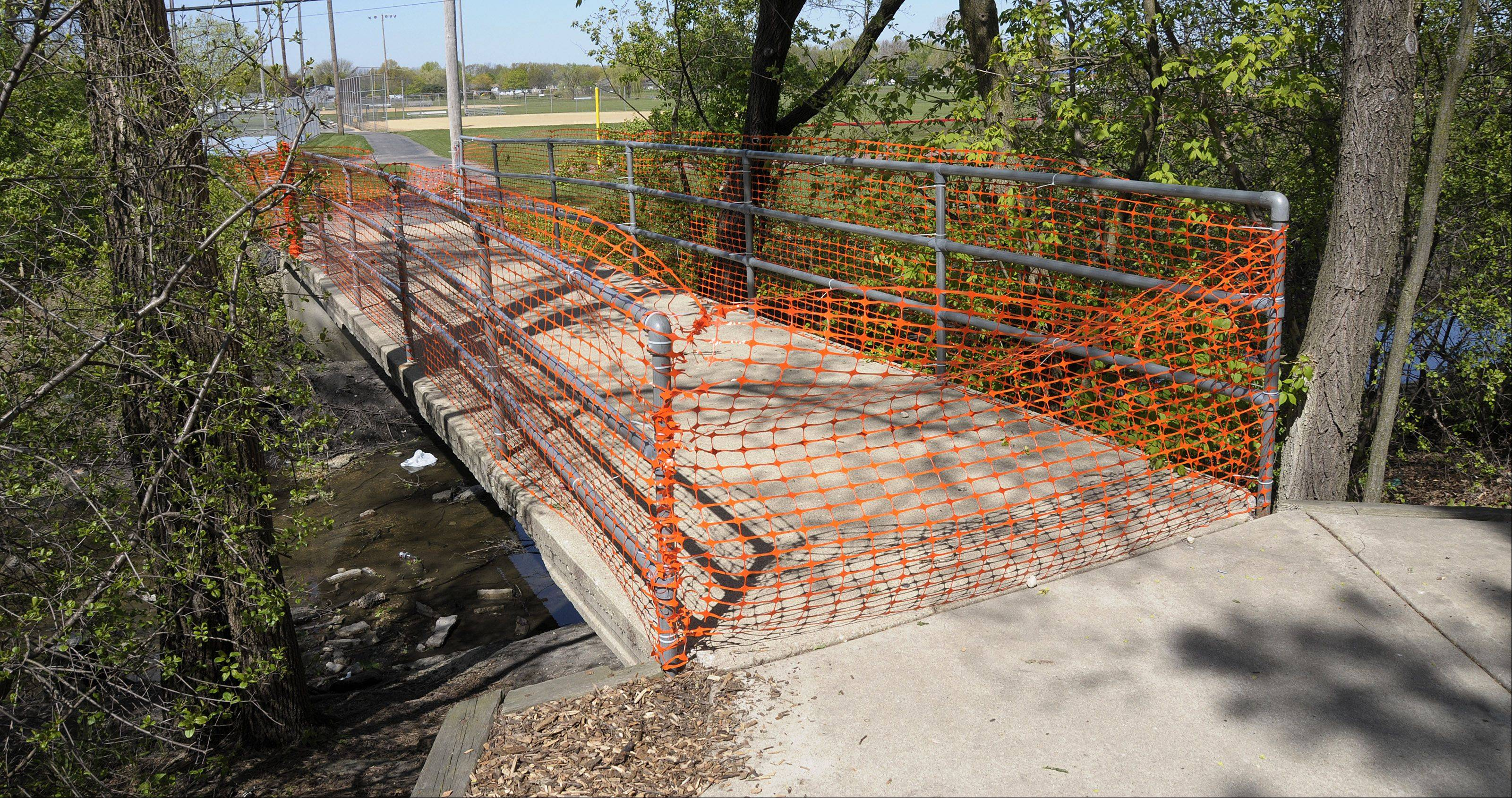 A pedestrian bridge between the Carol Stream Public Library and Armstrong Park has been closed due to safety concerns that arose when a chunk of concrete fell from it last month.