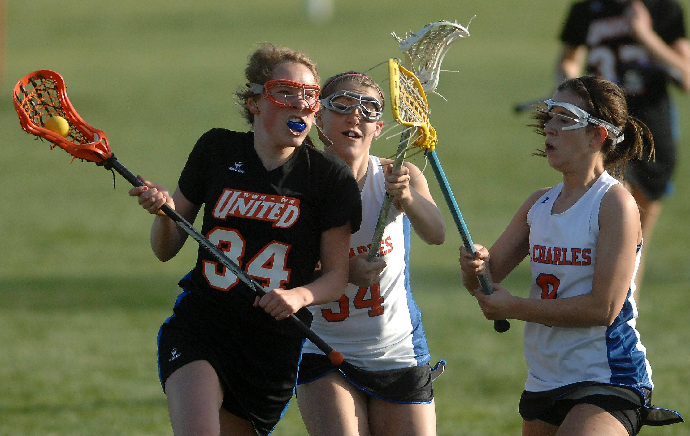 Wheaton United's Mary Budz prepares to shoot before scoring against St. Charles co-op.