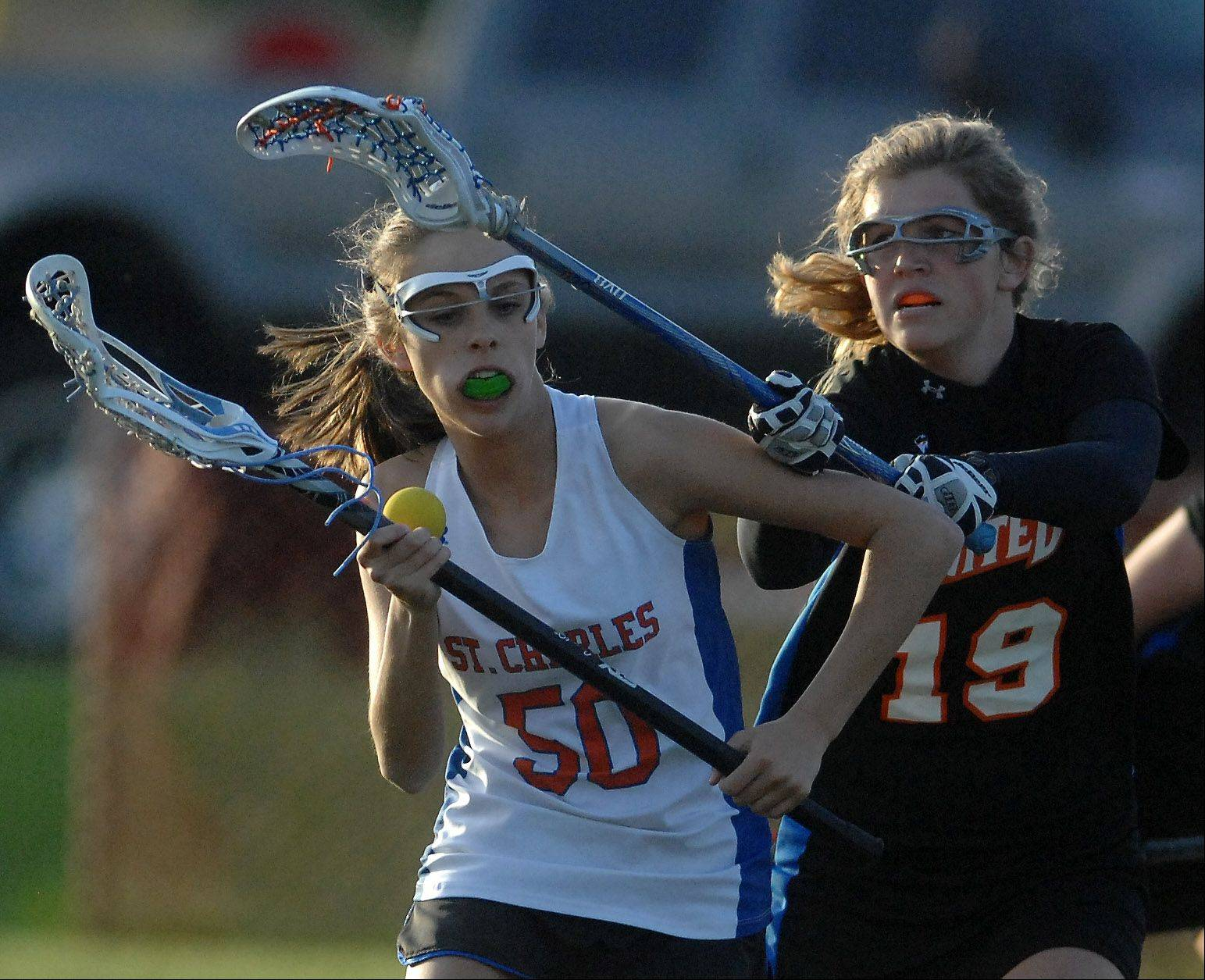 Images from the St. Charles co-op vs. Wheaton United girls lacrosse match Thursday, April 12, 2012.