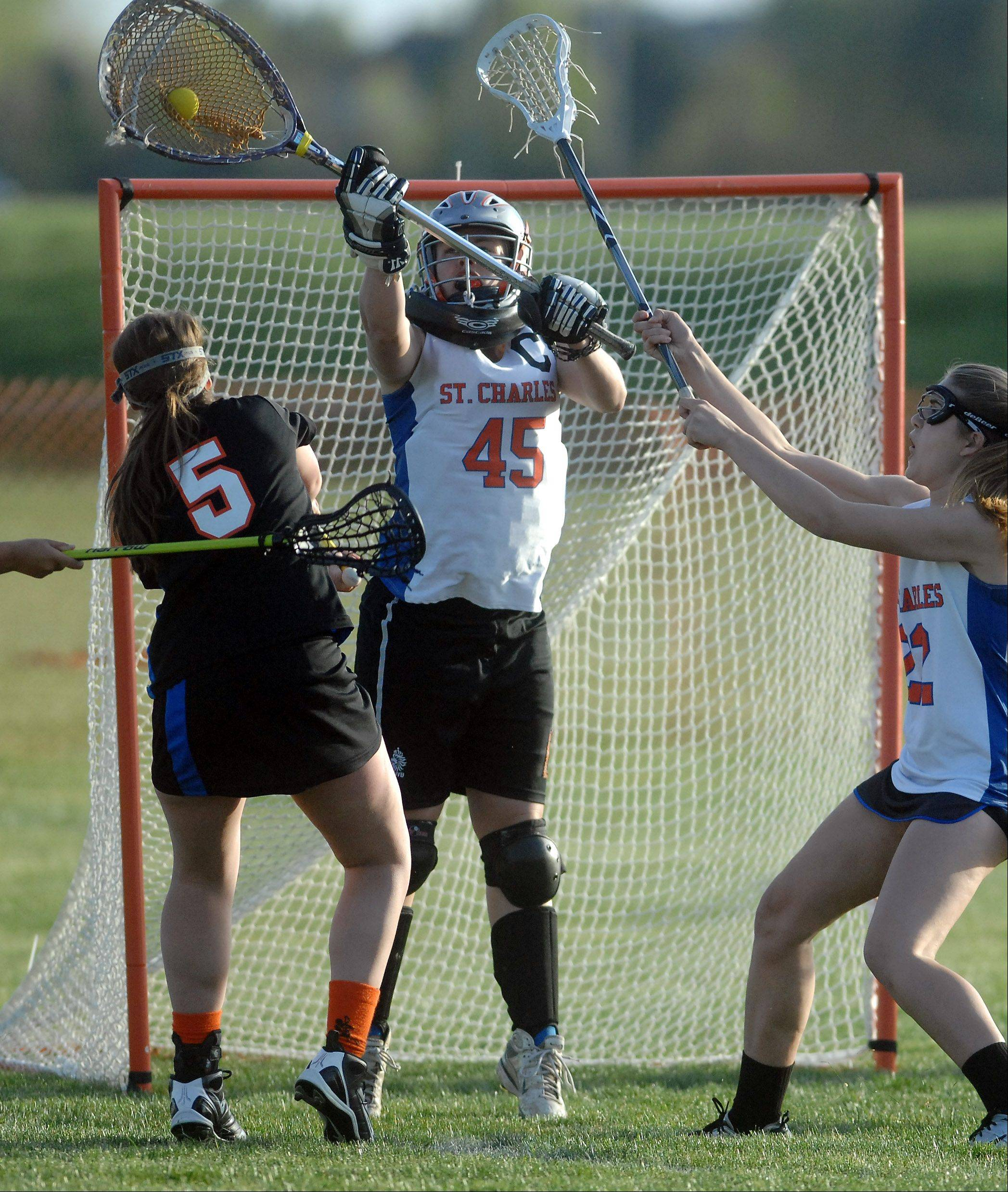 St. Charles co-op goalie Margaret Zimmer makes a save off a shot by Wheaton United's Jennine Fischer.
