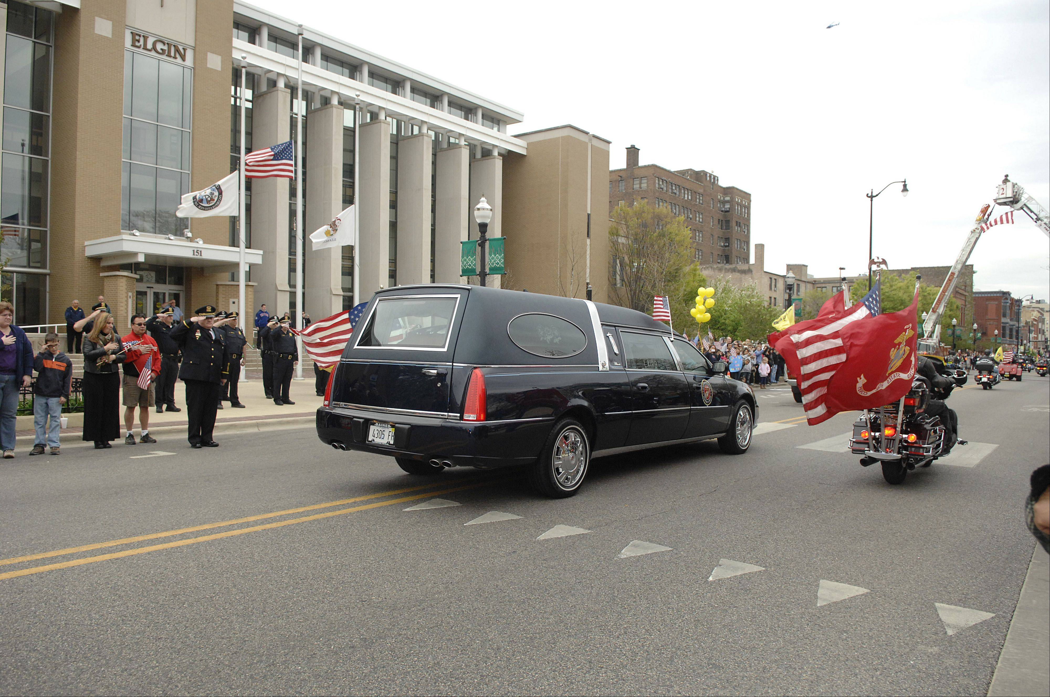 Solemn ride home for fallen Elgin Marine