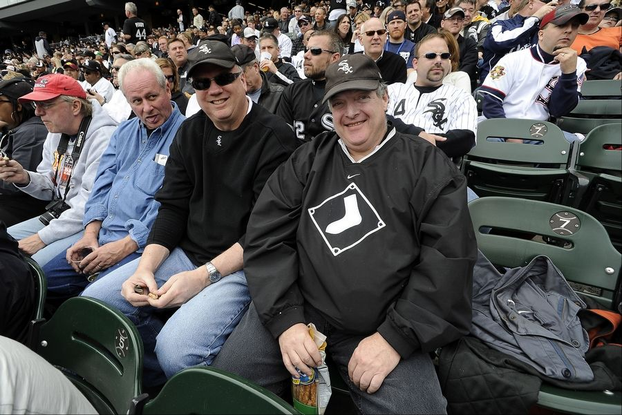 Libertyville's Howard Jaffe, 58, (front, right) witnesses his 50th consecutive White Sox opening day with good friends, from left, Steve Risley, Mike Cuccinelli and Tom Miller.