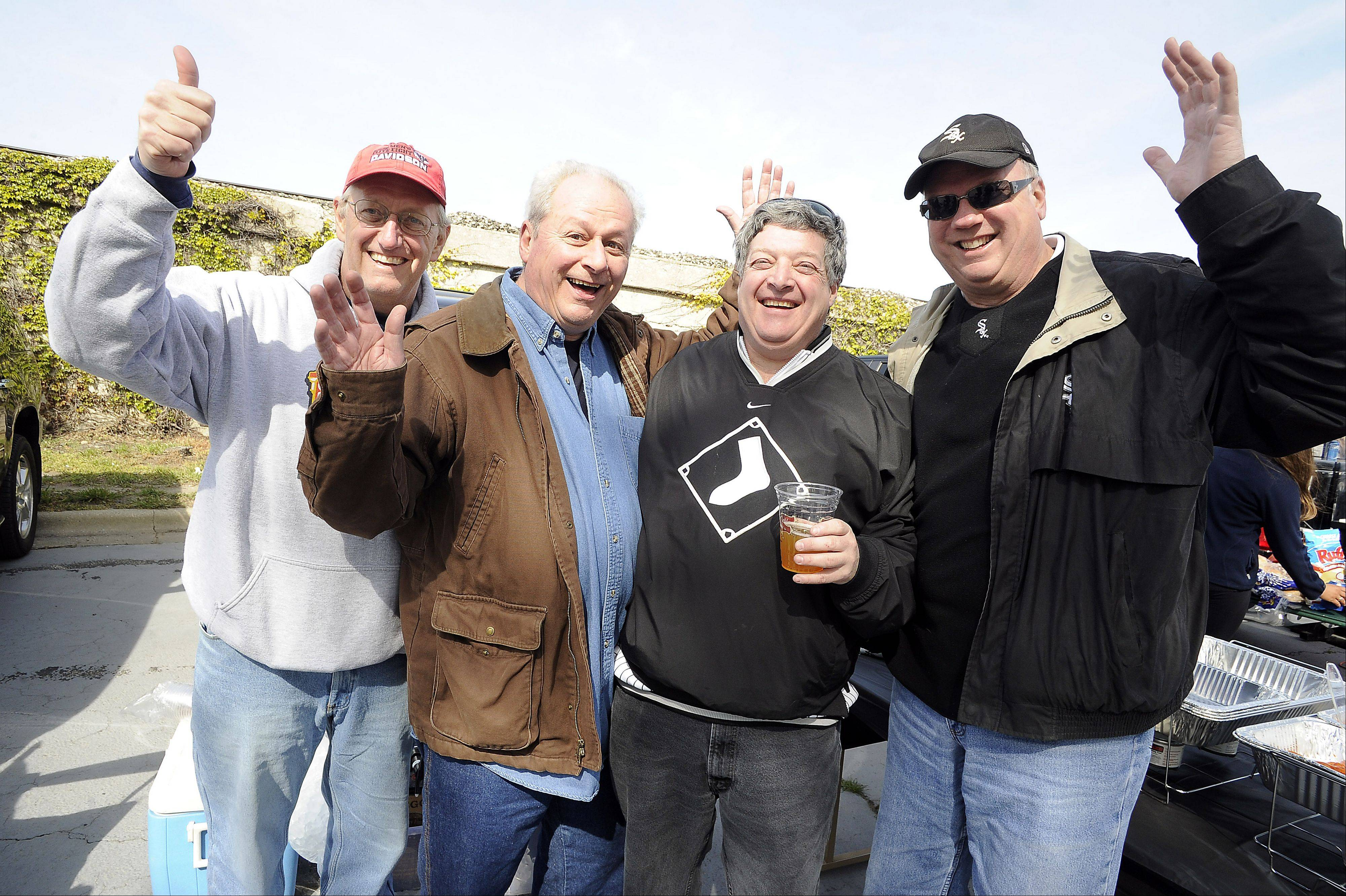 Wearing his black Sox shirt, Libertyville's Howard Jaffe, 58, second from right, attends his 50th consecutive White Sox Opening Day. Buddies, from left, Steve Risley of Libertyville, Mike Cuccinelli of Roscoe and Tom Miller of Libertyville enjoy tailgating before the game.