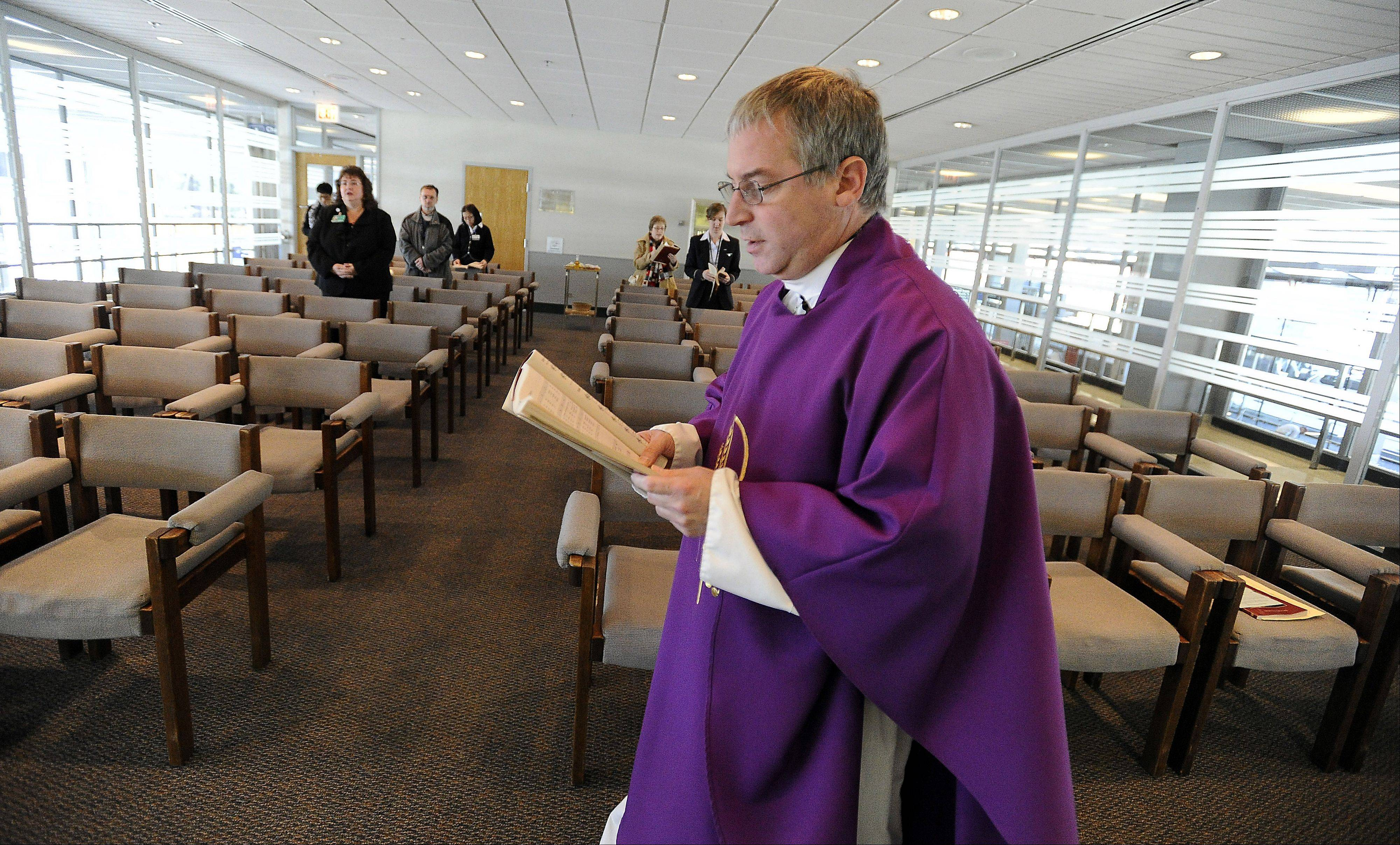 Father Mike says Mass in the Interfaith Chapel for travelers and airport personnel on a daily basis.