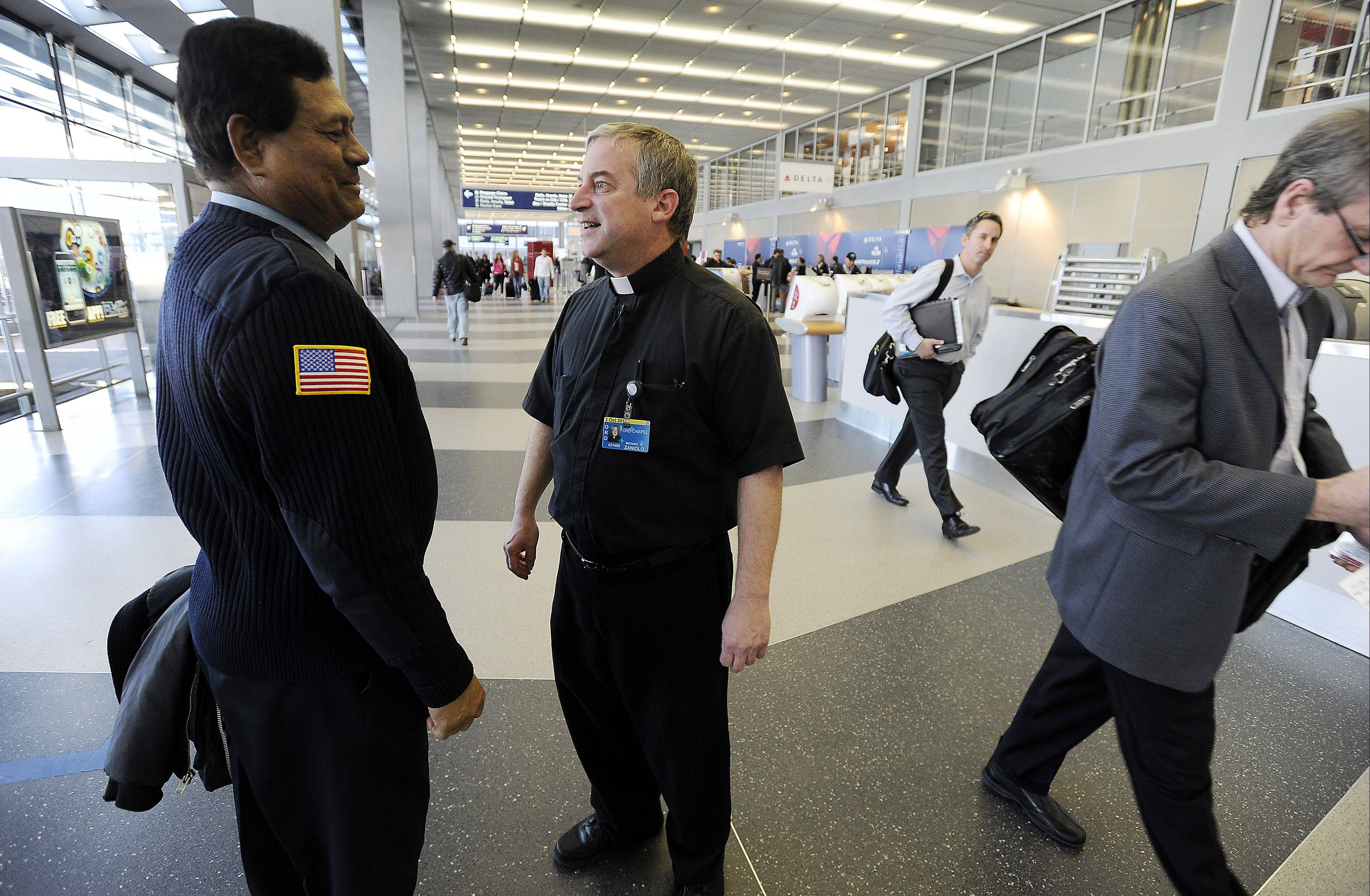 The Rev. Michael Zaniolo ventures onto the concourse in Terminal 2 to meet and greet anyone who might need his services.