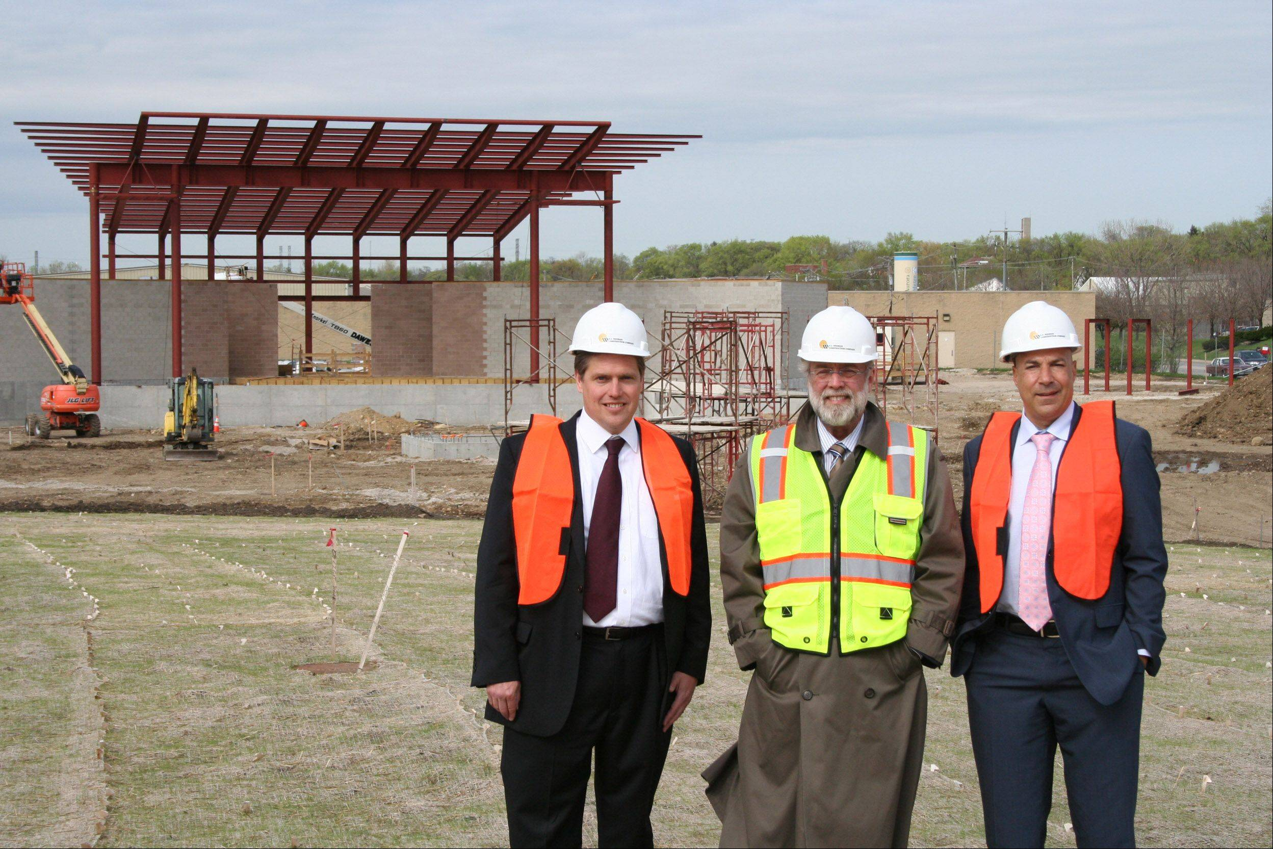 The city of Aurora still has $854,057 left to spend on RiverEdge Park, where Aurora Mayor Tom Weisner stands with Dunham Fund board Chairman Stewart Beach, left, and Dunham Fund board member Michael Morcos, right. Grants totaling $13 million are supporting the park's construction, which is budgeted to cost $13.2 million.