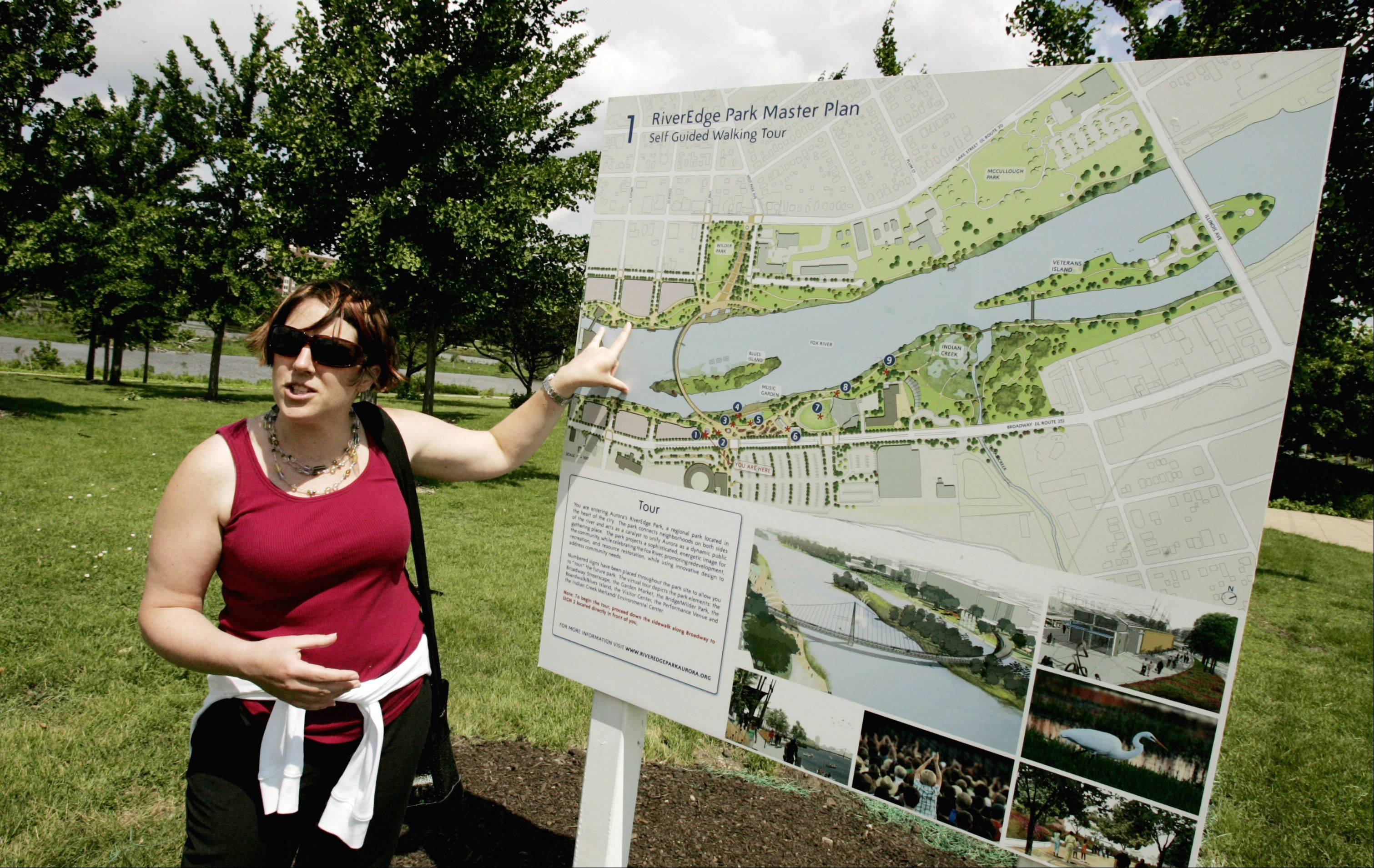 Aurora planning and zoning Director Stephane Phifer shows RiverEdge Park and a view of its master plan, which was approved in 2007.