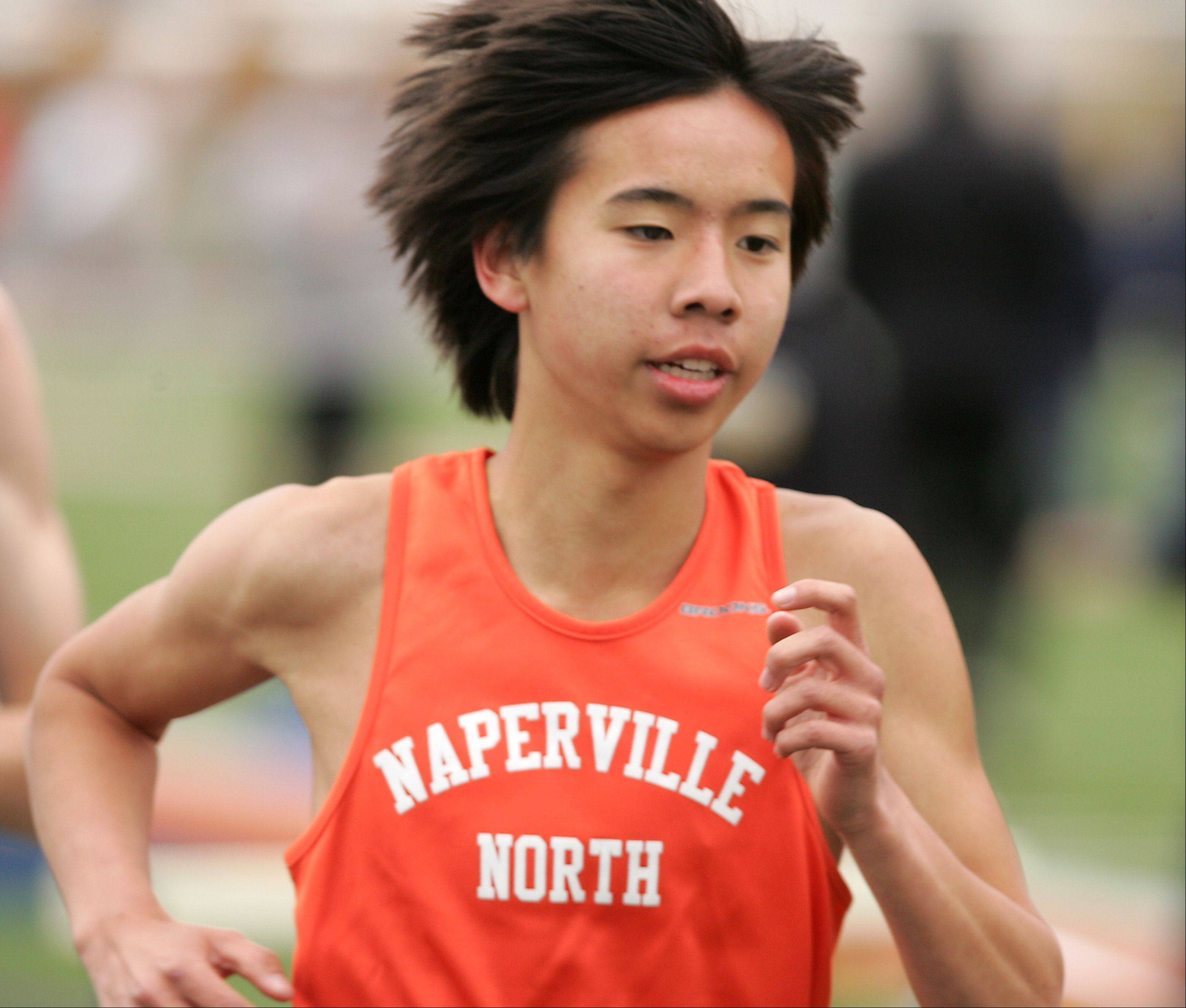 "Naperville North's Jimmy Qiao wins the Boys 3200 Meter Run, during the ""Gus Scott Classic"" Boys and Girls Track Invitational at Naperville North High School."