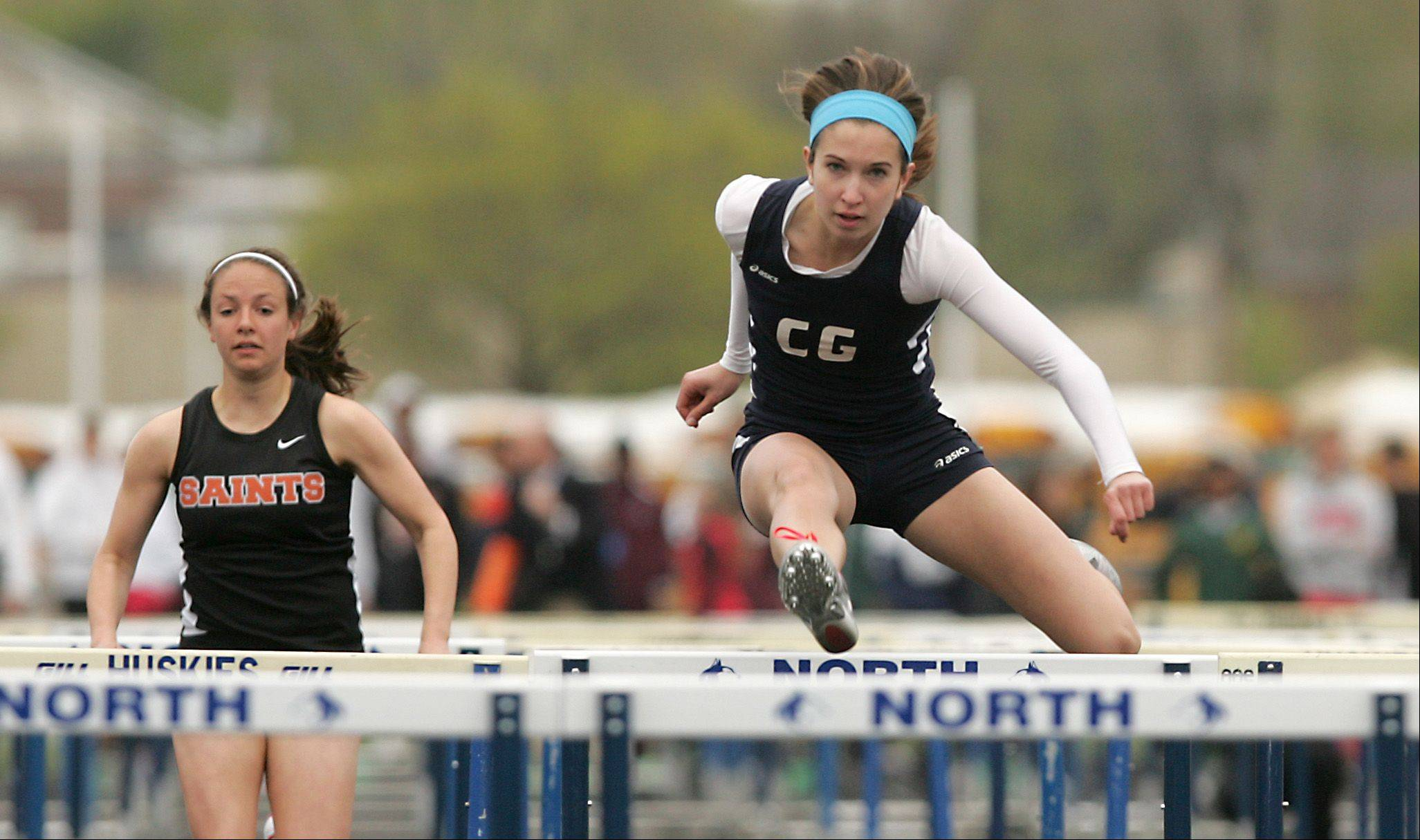 "Cary Grove's Kathie Wollney runs the Girls 100 Meter Hurdles, during the ""Gus Scott Classic"" Boys and Girls Track Invitational at Naperville North High School."