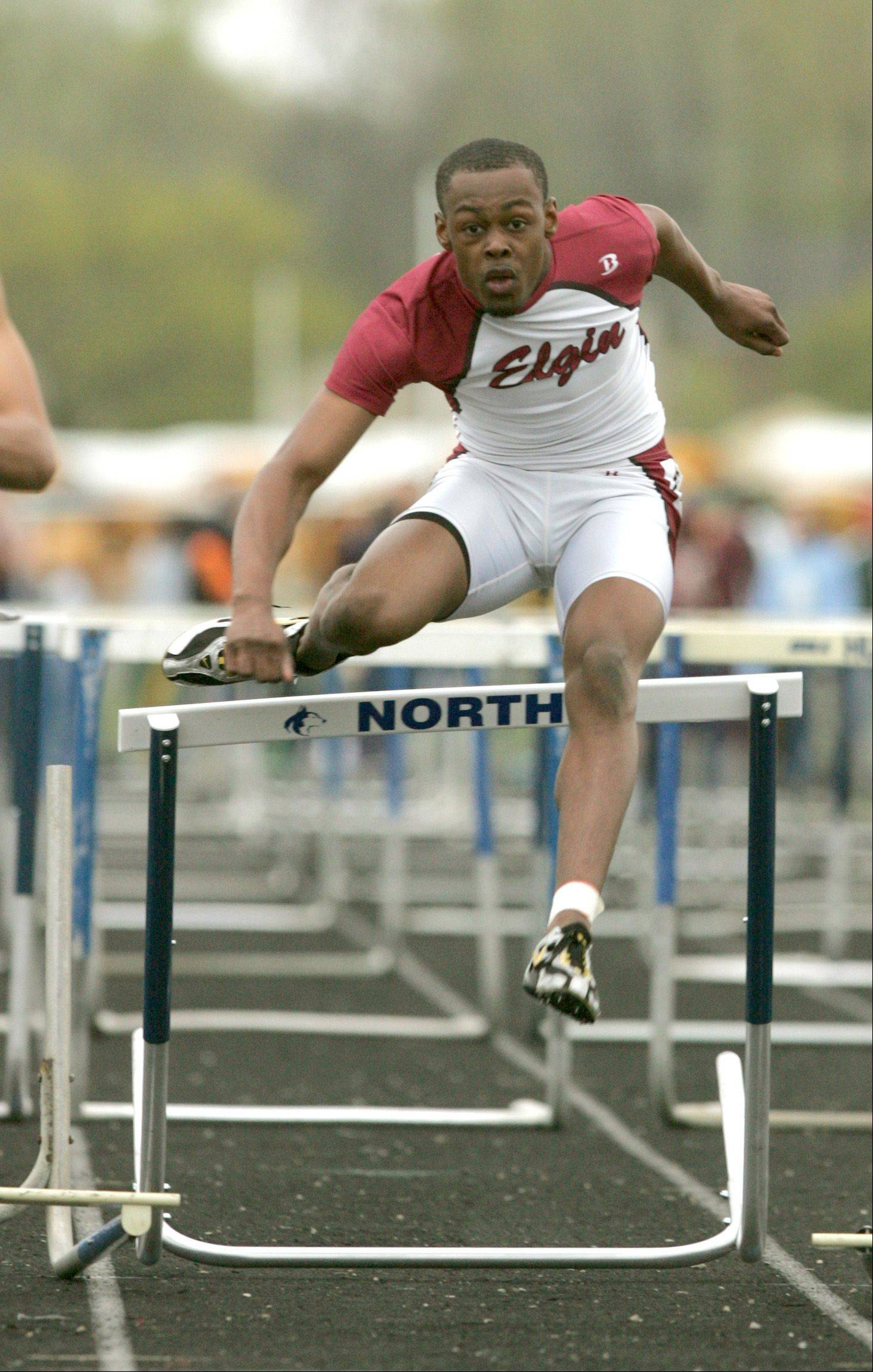 "Elgin's Devante King runs the Boys 100 Meter Hurdles, during the ""Gus Scott Classic"" Boys and Girls Track Invitational at Naperville North High School."