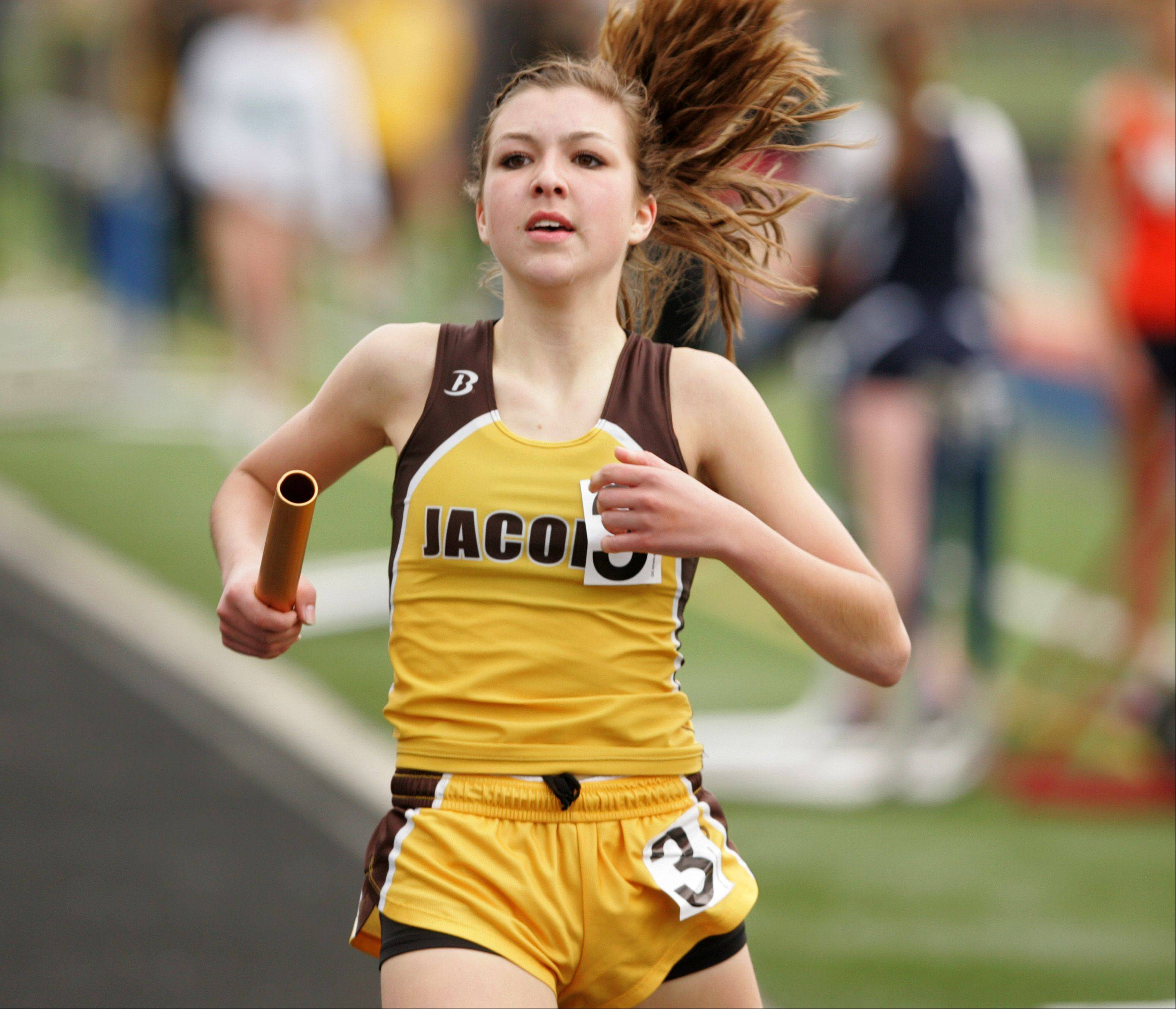 "Jacob's Kayla Giuliano anchors the finishing leg of the 4x800 Meter Relay, during the ""Gus Scott Classic"" Boys and Girls Track Invitational at Naperville North High School."