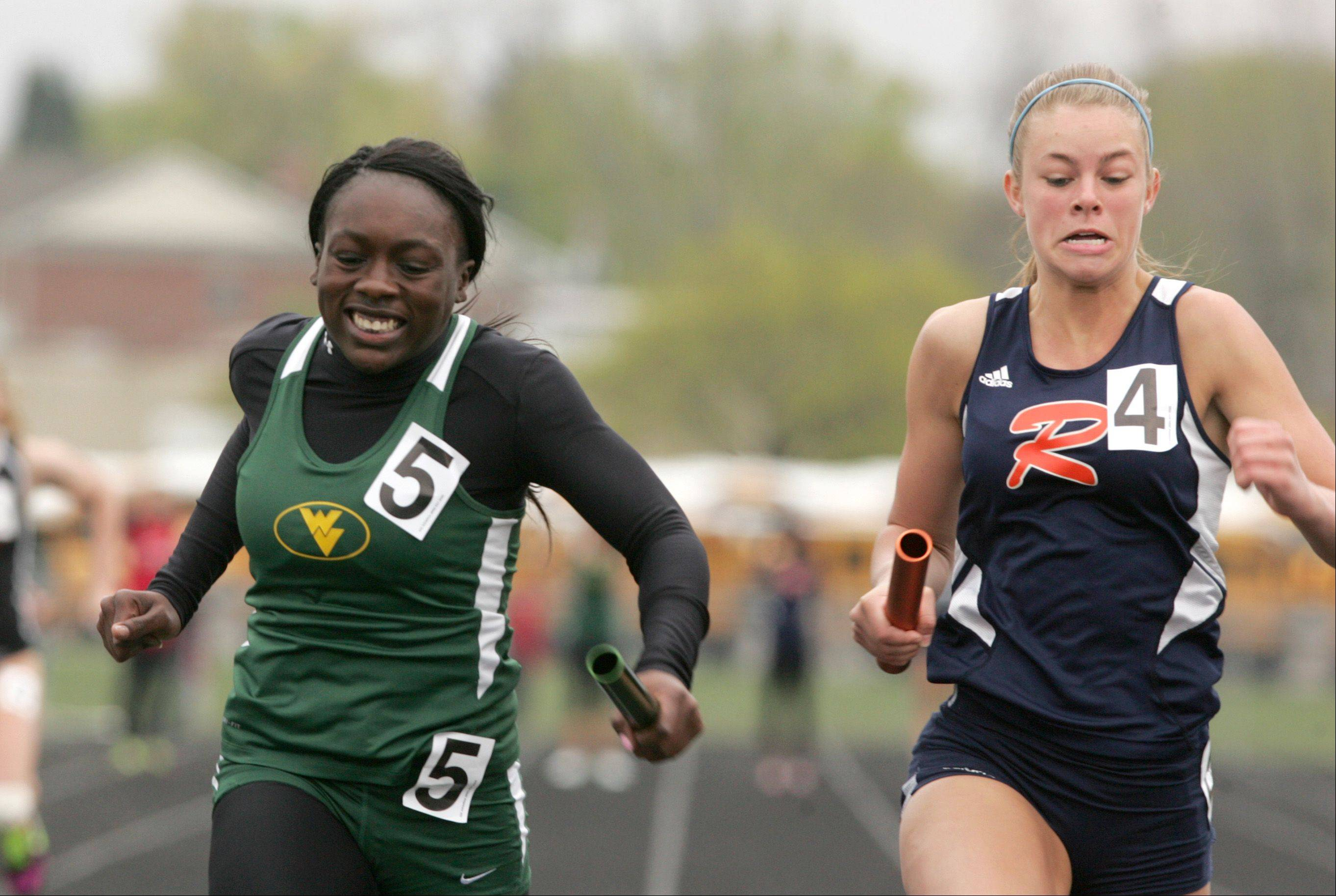 "Waubonsie Valley's Morolake Akinosun anchors a first place finish in the 4x100 Meter Relay, during the ""Gus Scott Classic"" Boys and Girls Track Invitational at Naperville North High School."