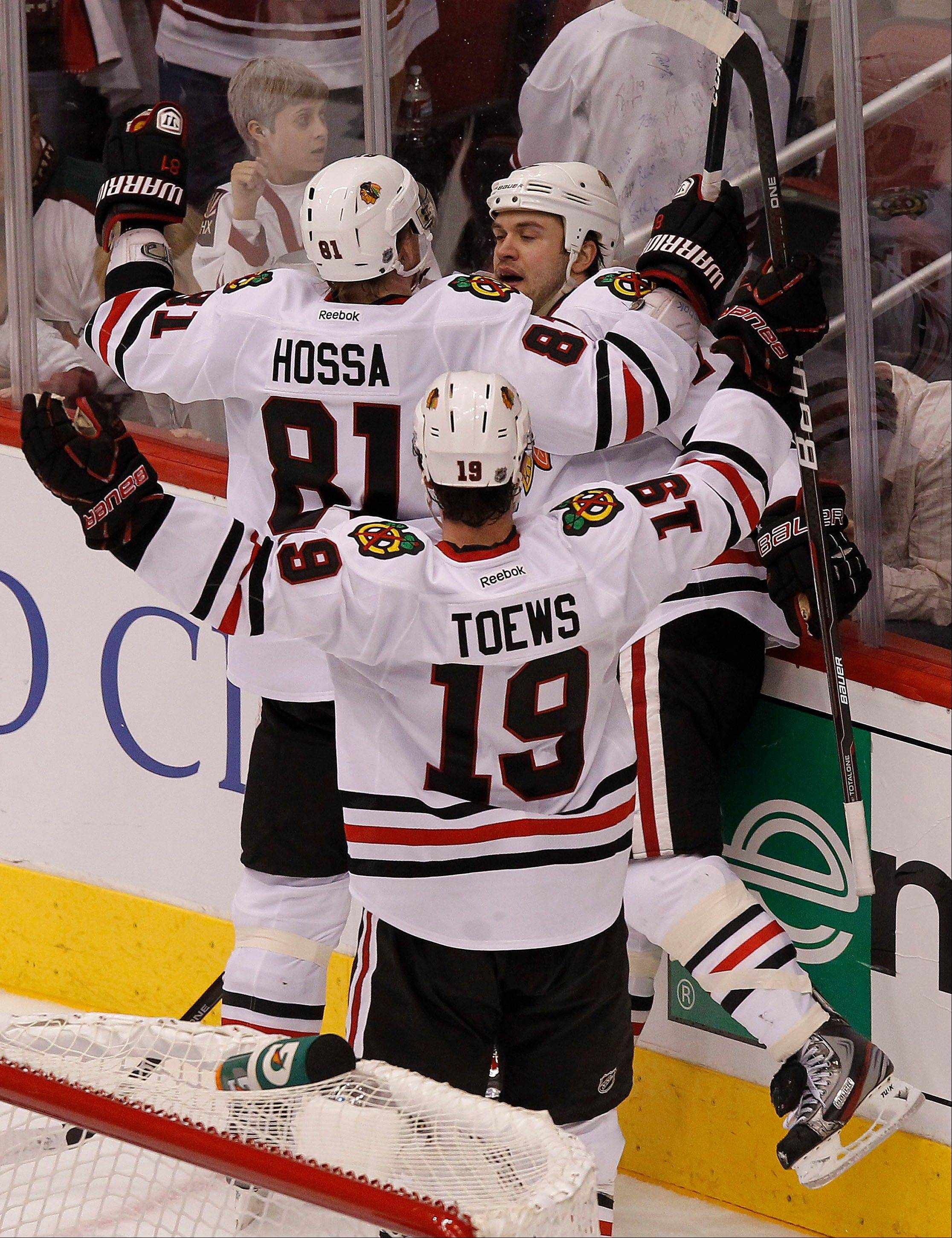 The Blackhawks' Brent Seabrook celebrates his game-tying goal with teammates Marian Hossa and Jonathan Toews with 14 seconds left in regulation in Game 1 on Thursday night. The Hawks fell in overtime.