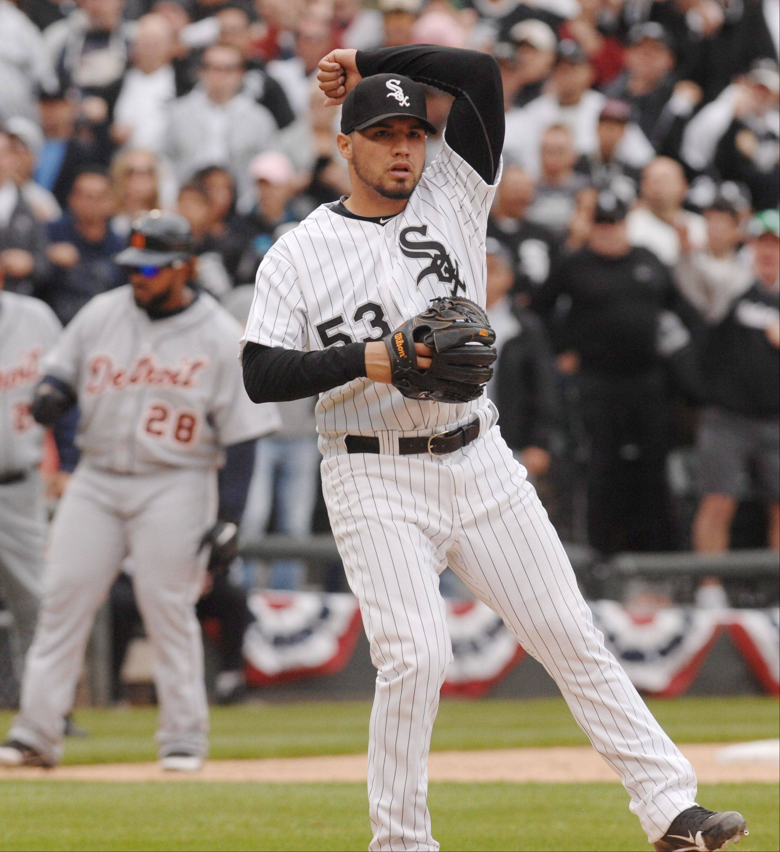 White Sox pitcher Hector Santiago celebrates his victory over the Tigers as he pumps his fist in the 5-2 opening game in Chicago on Friday.