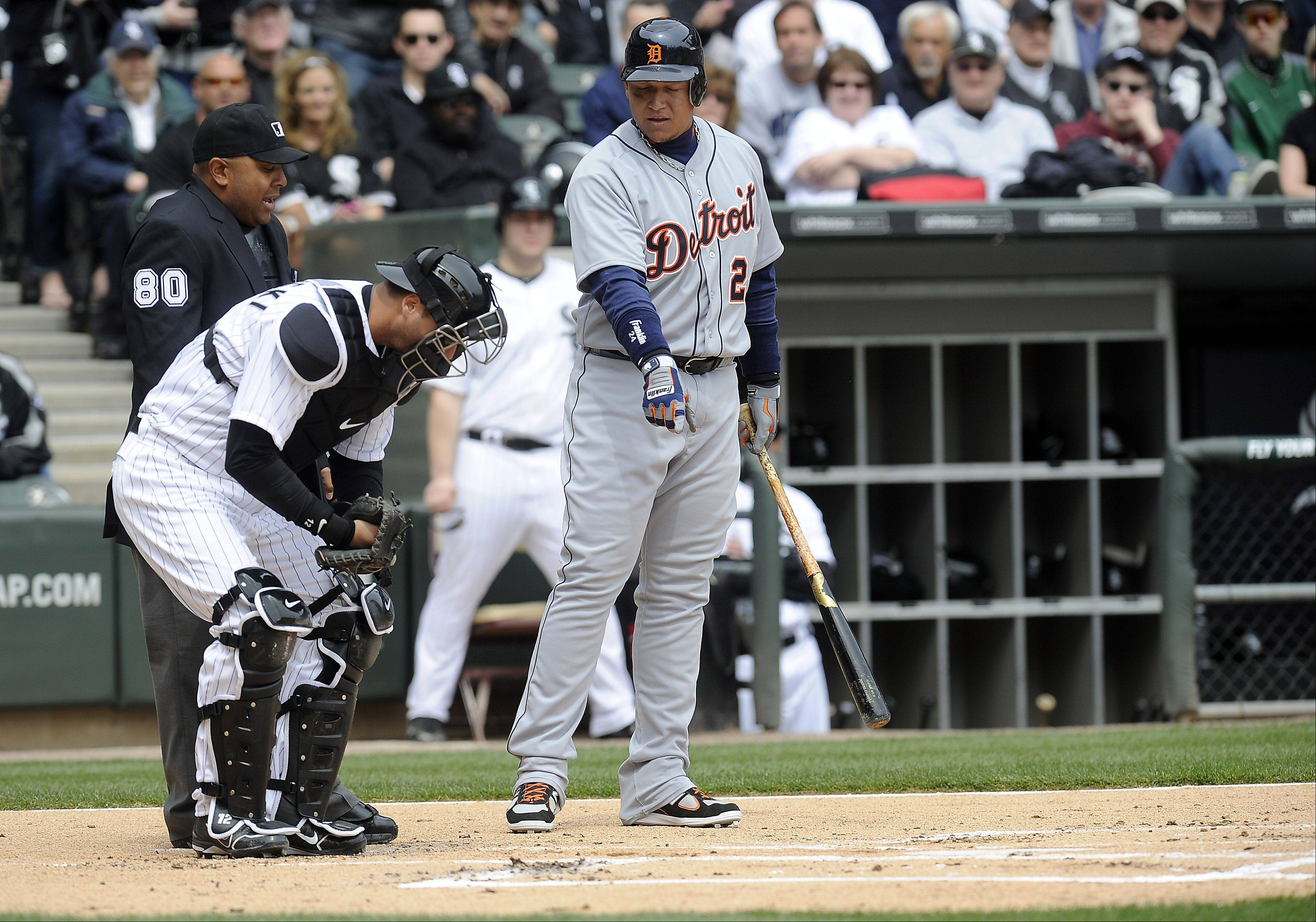 Tiger Miguel Cabrera complains about the batter box in the first inning.