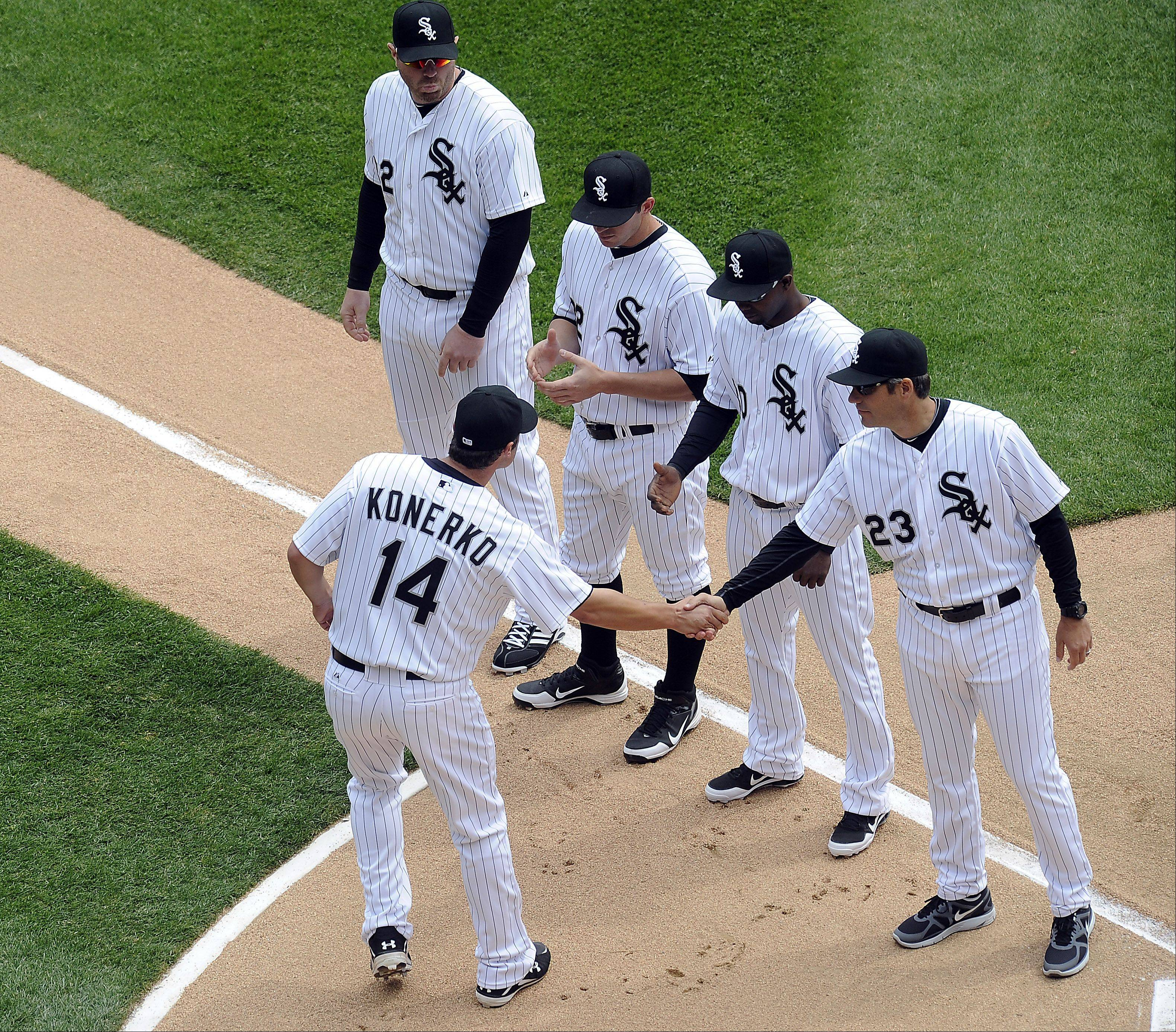 White Sox player Paul Konerko greets his teammates as the starting lineup is announced.