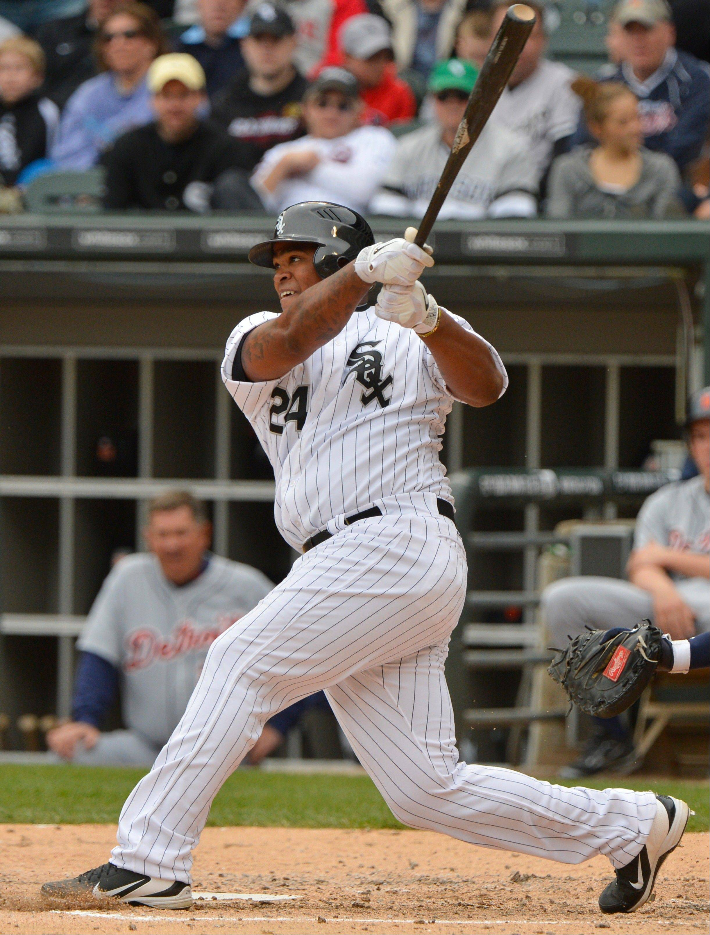 Chicago White Sox's Dayan Viciedo hits a solo home run during the fifth inning.